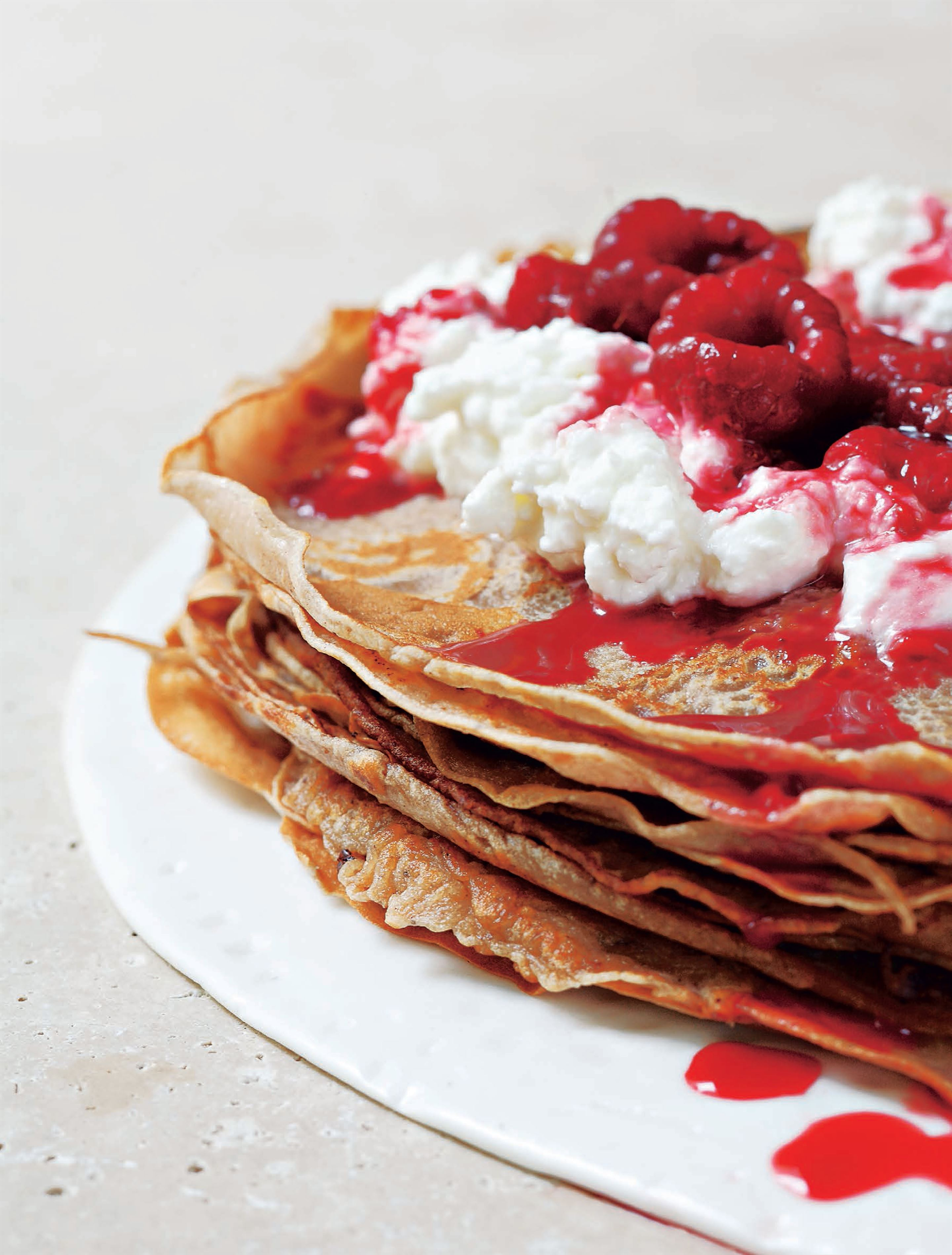 Chestnut crêpes with pan-fried raspberries and brocciu