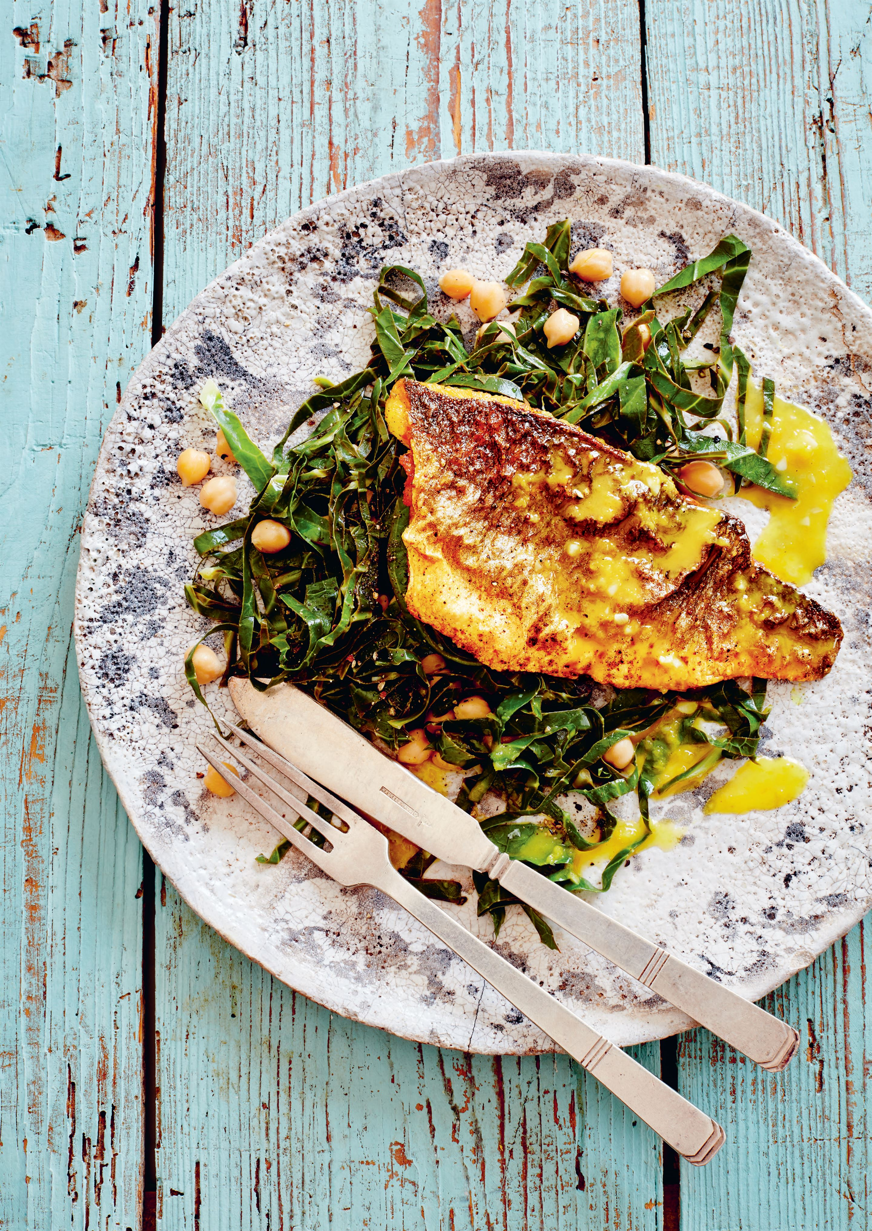 Spiced sea bass with citrus butter sauce