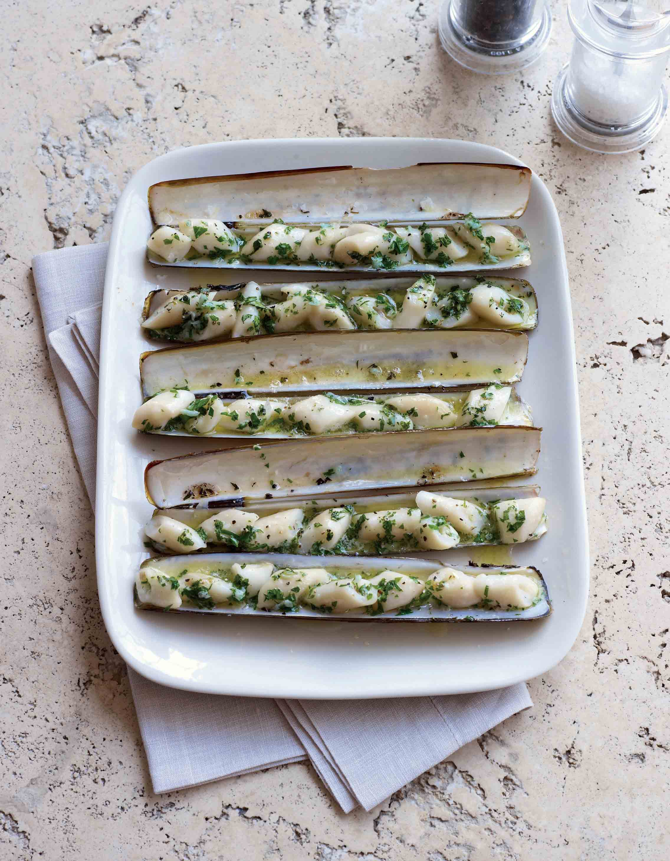 Grilled razor clams with a garlic parsley butter