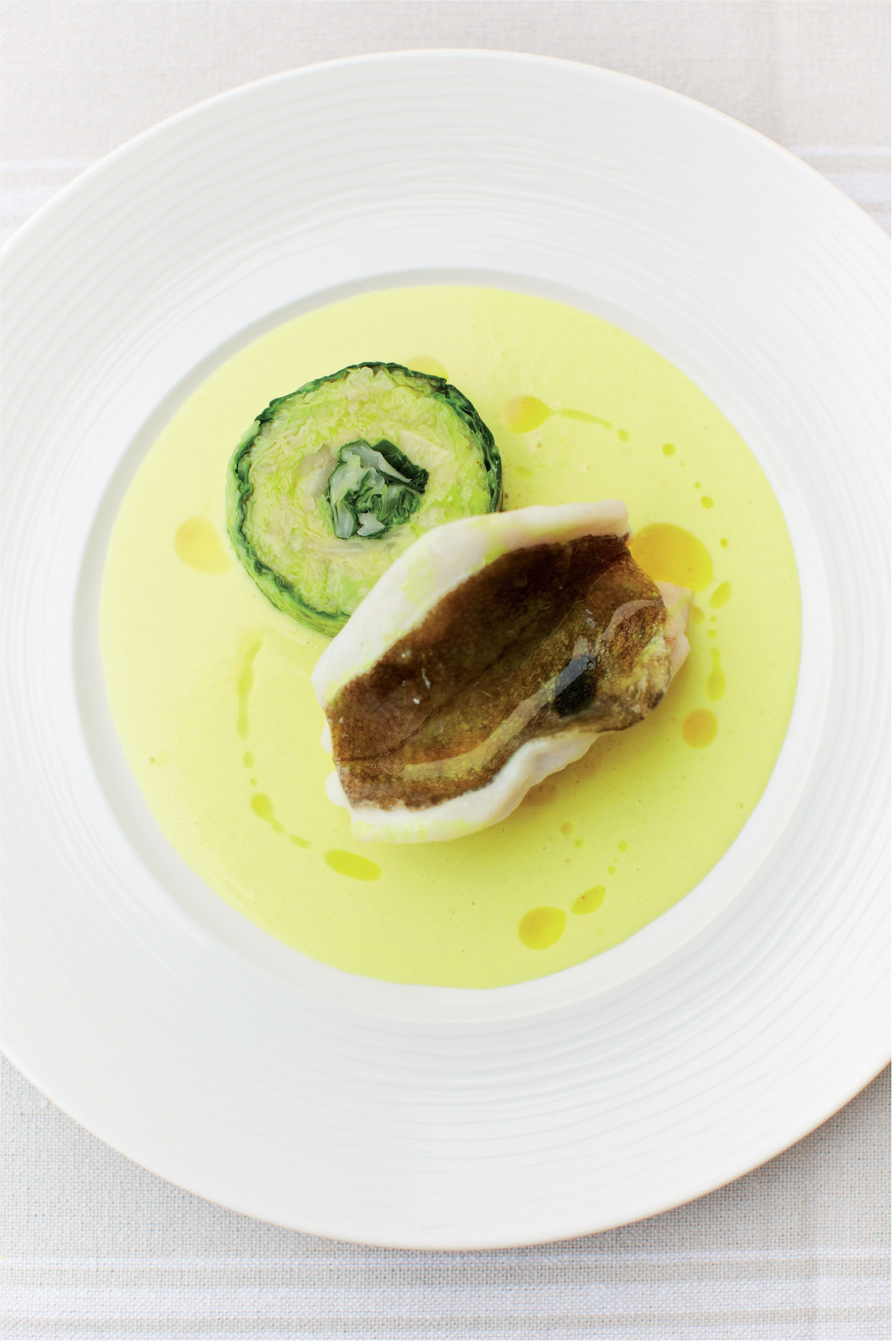 John Dory with curry sauce, cabbage and shallots