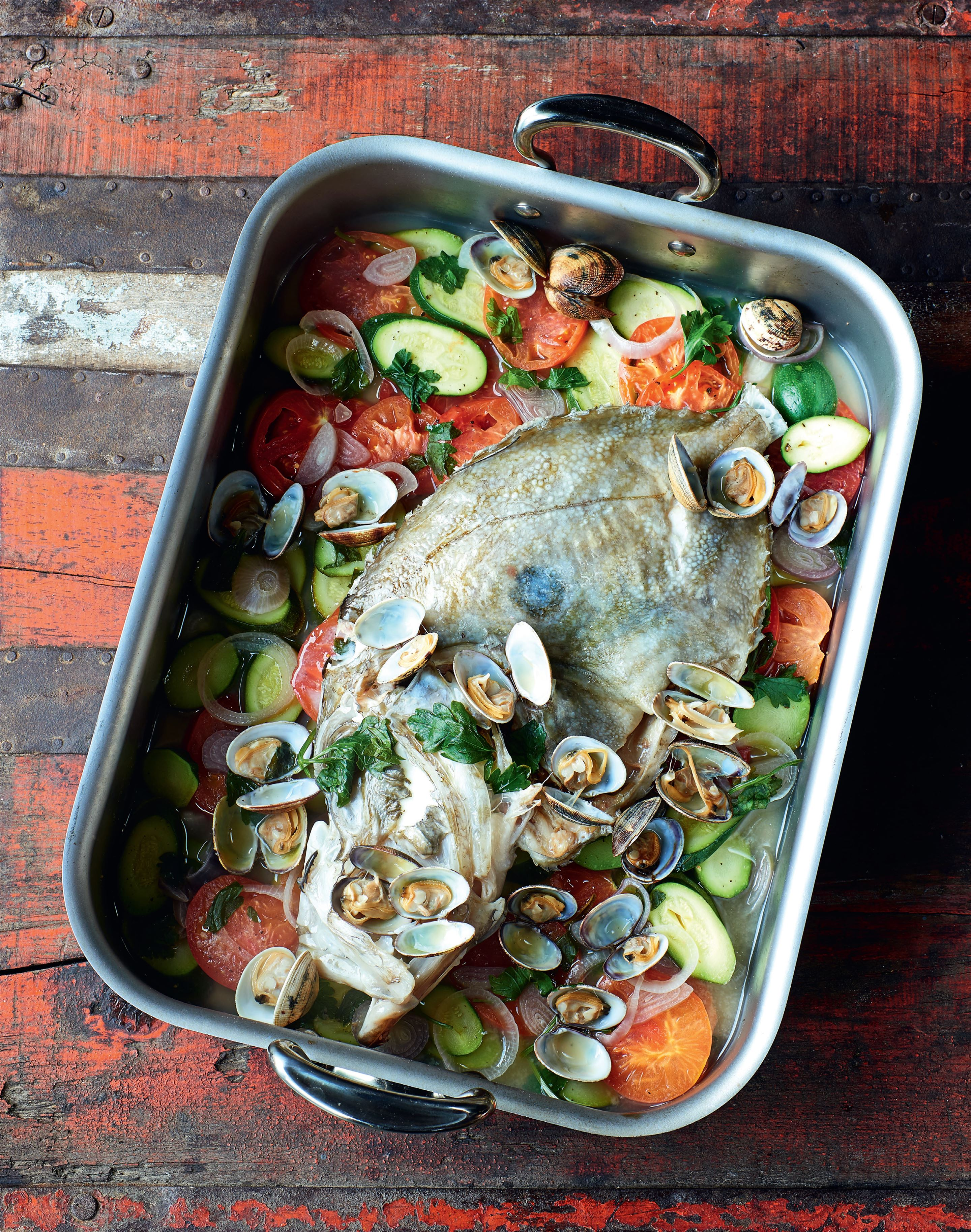 Whole John Dory with clams & courgettes