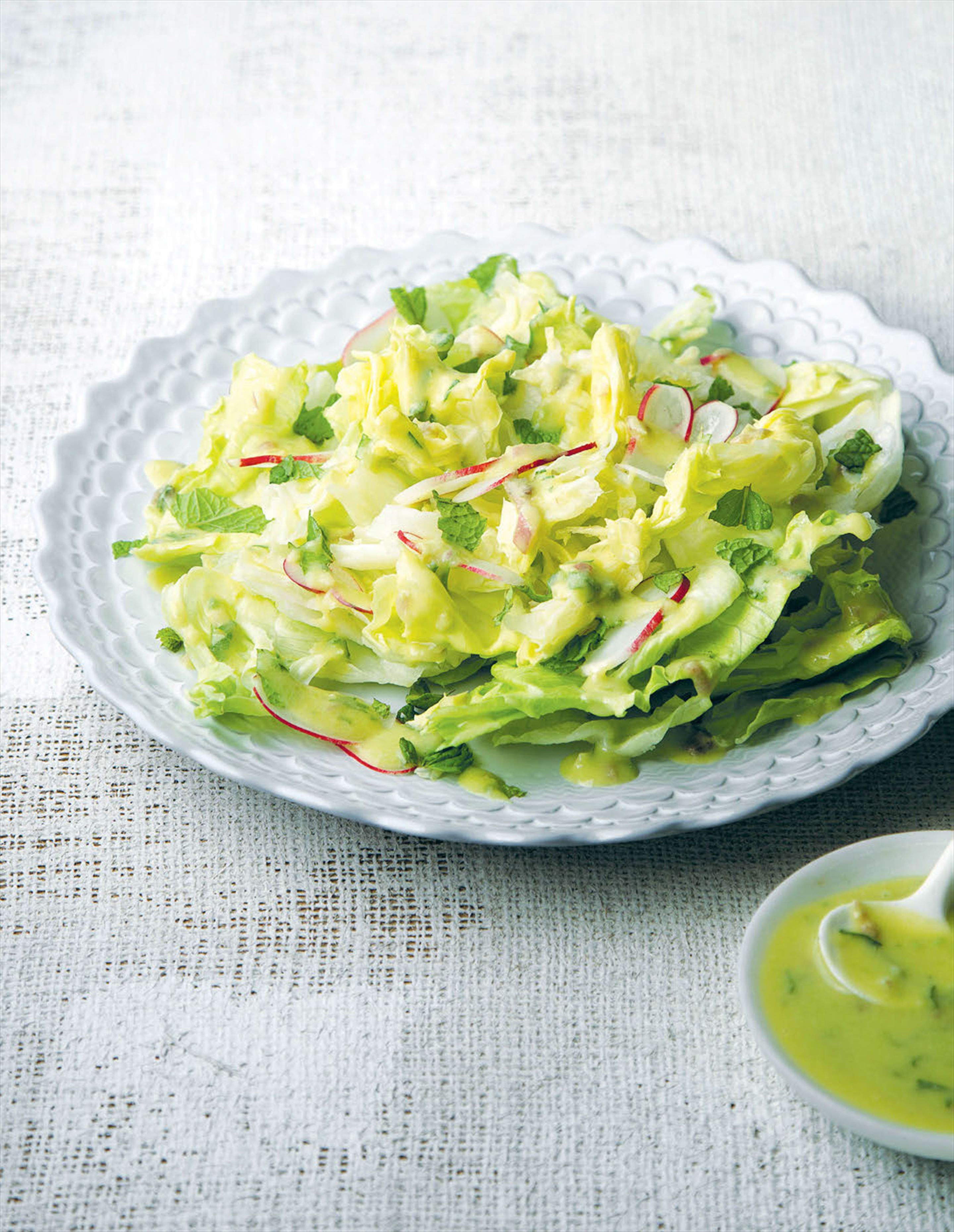 Iceberg lettuce with mint, radish and avocado dressing