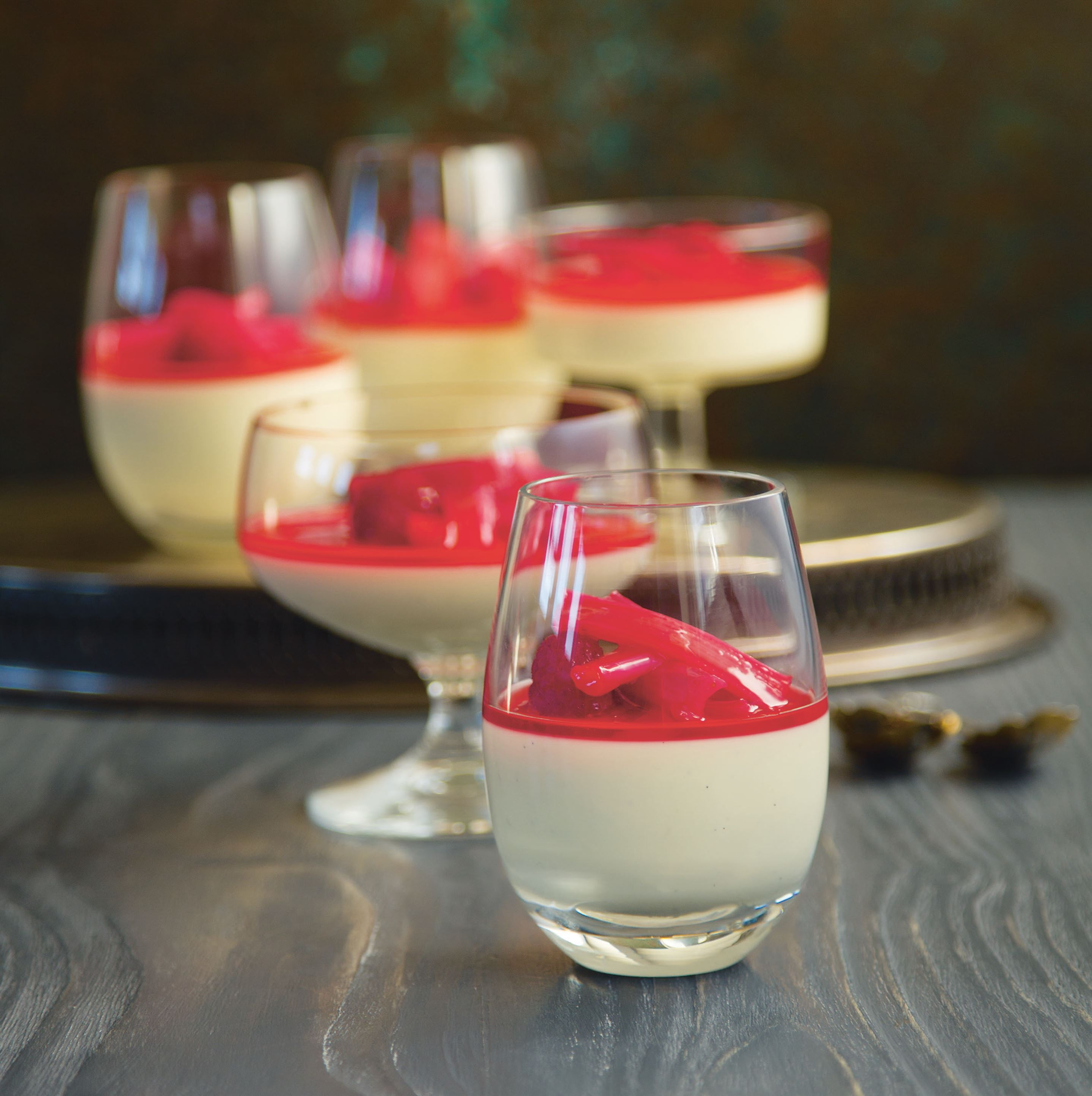 Mini lemon panna cotta pots with rhubarb and raspberries