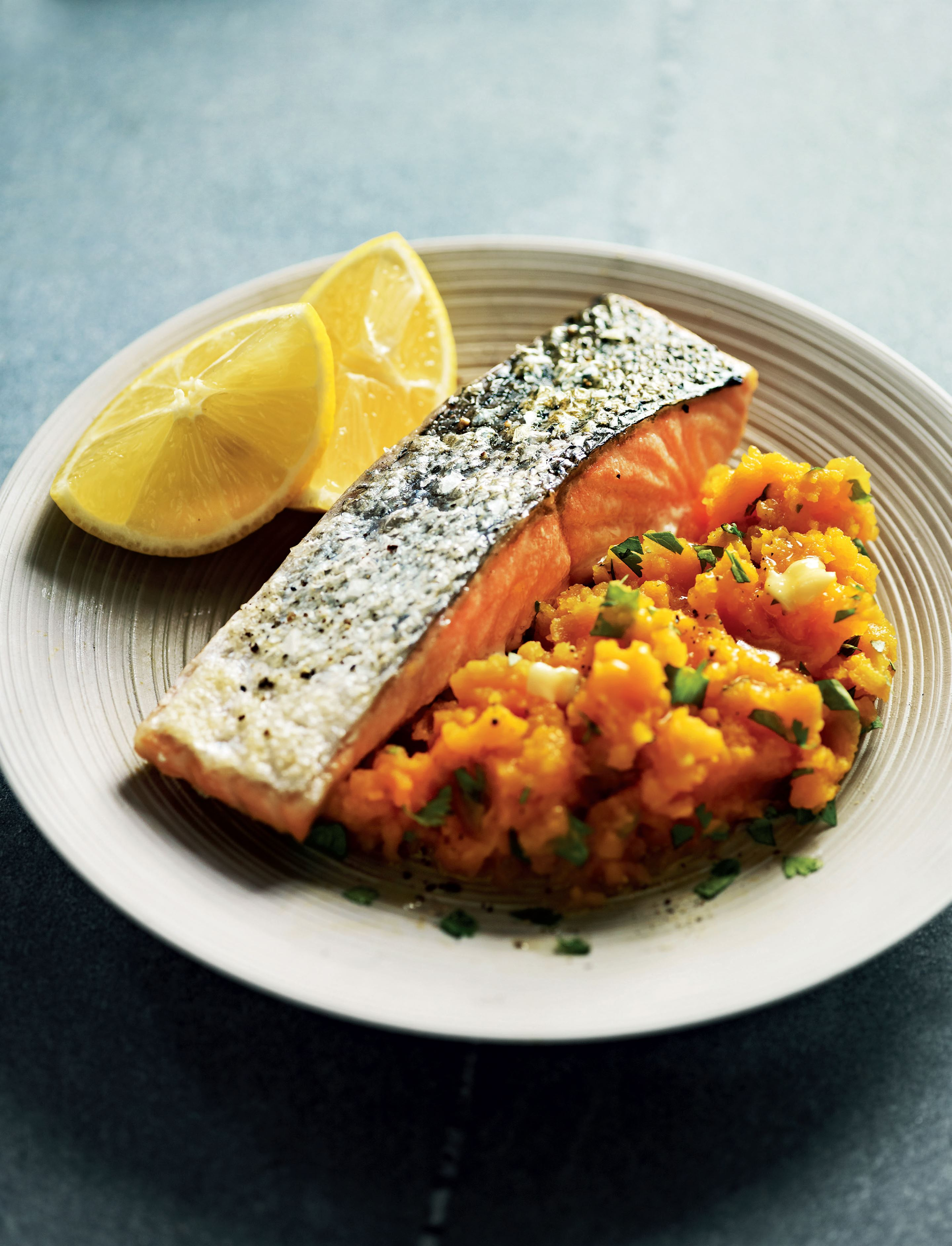 Grilled salmon with spinach and spiced carrot mash