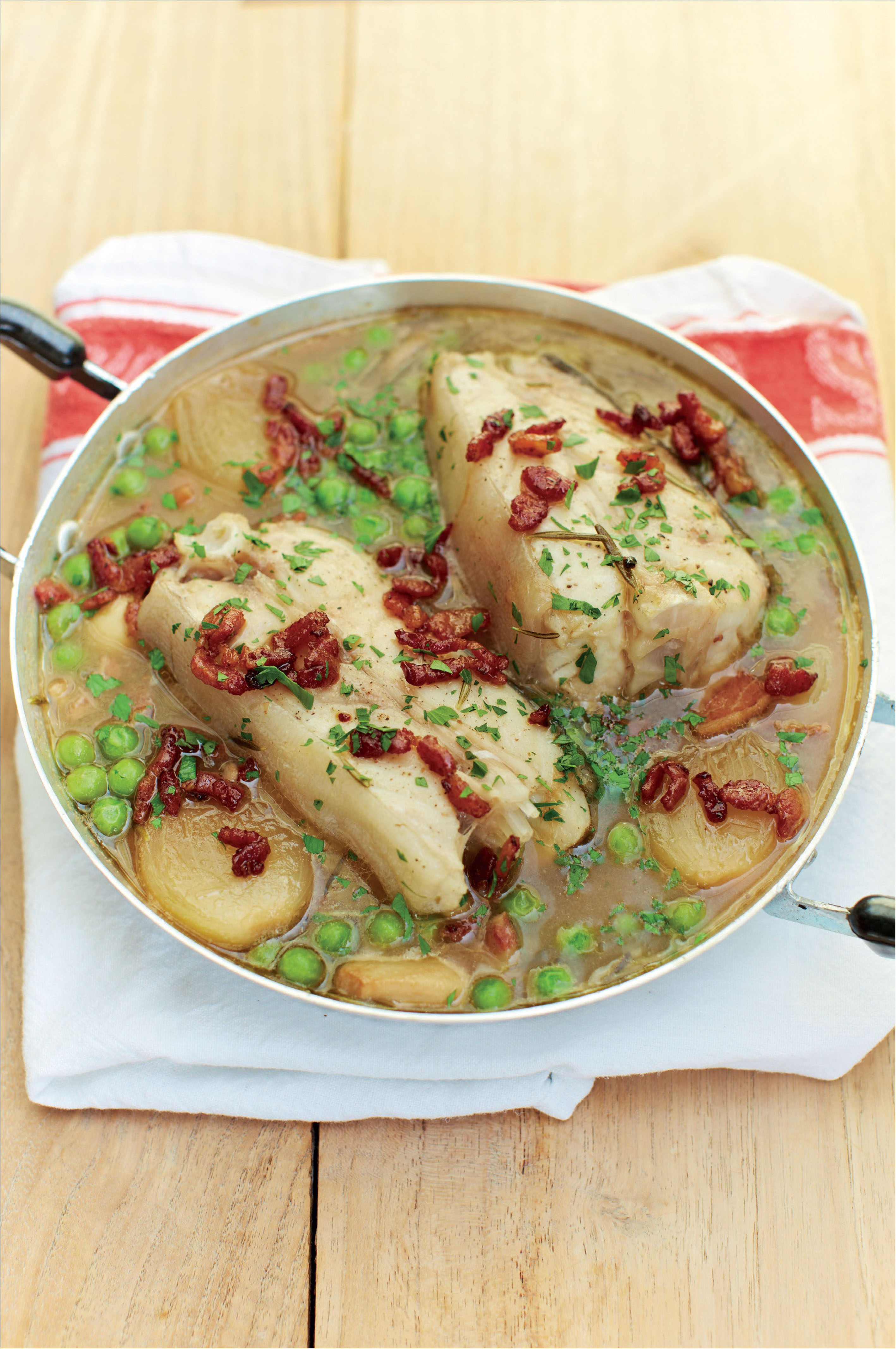 Braised turbot in beer with bacon, shallots and peas
