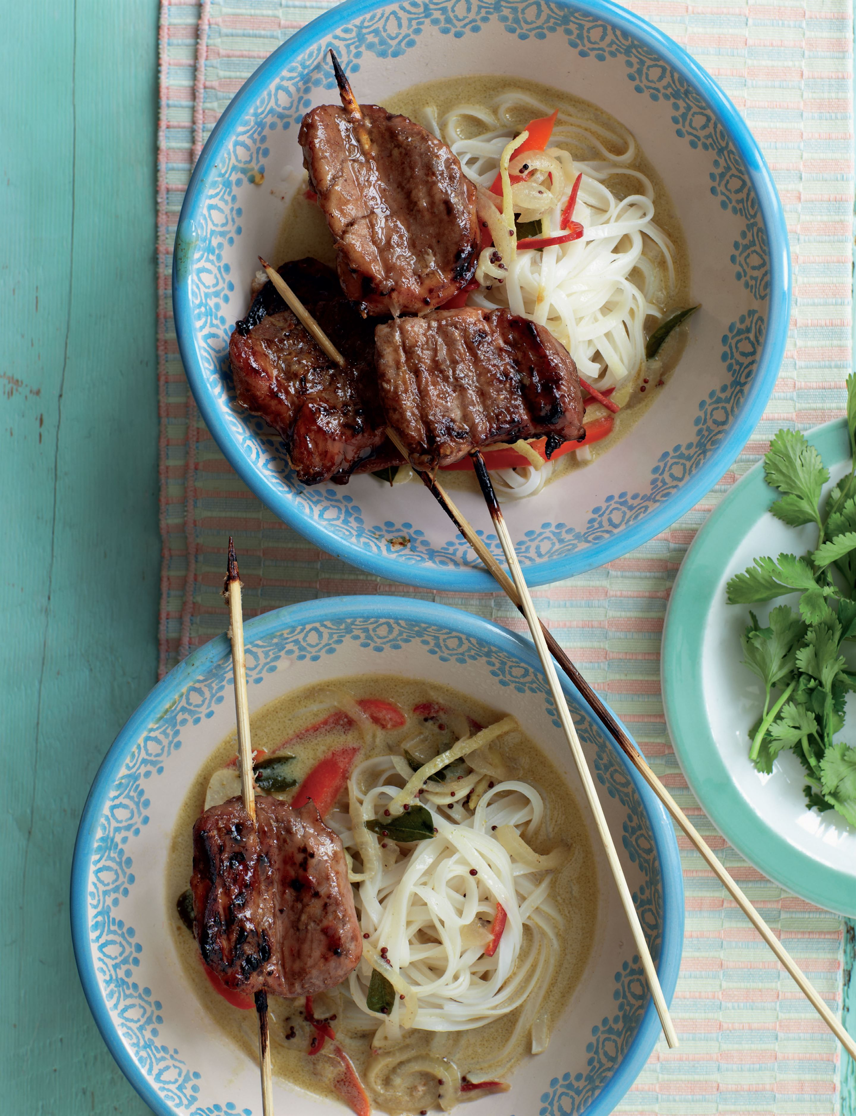 Quick-grilled pork with noodles and coconut broth
