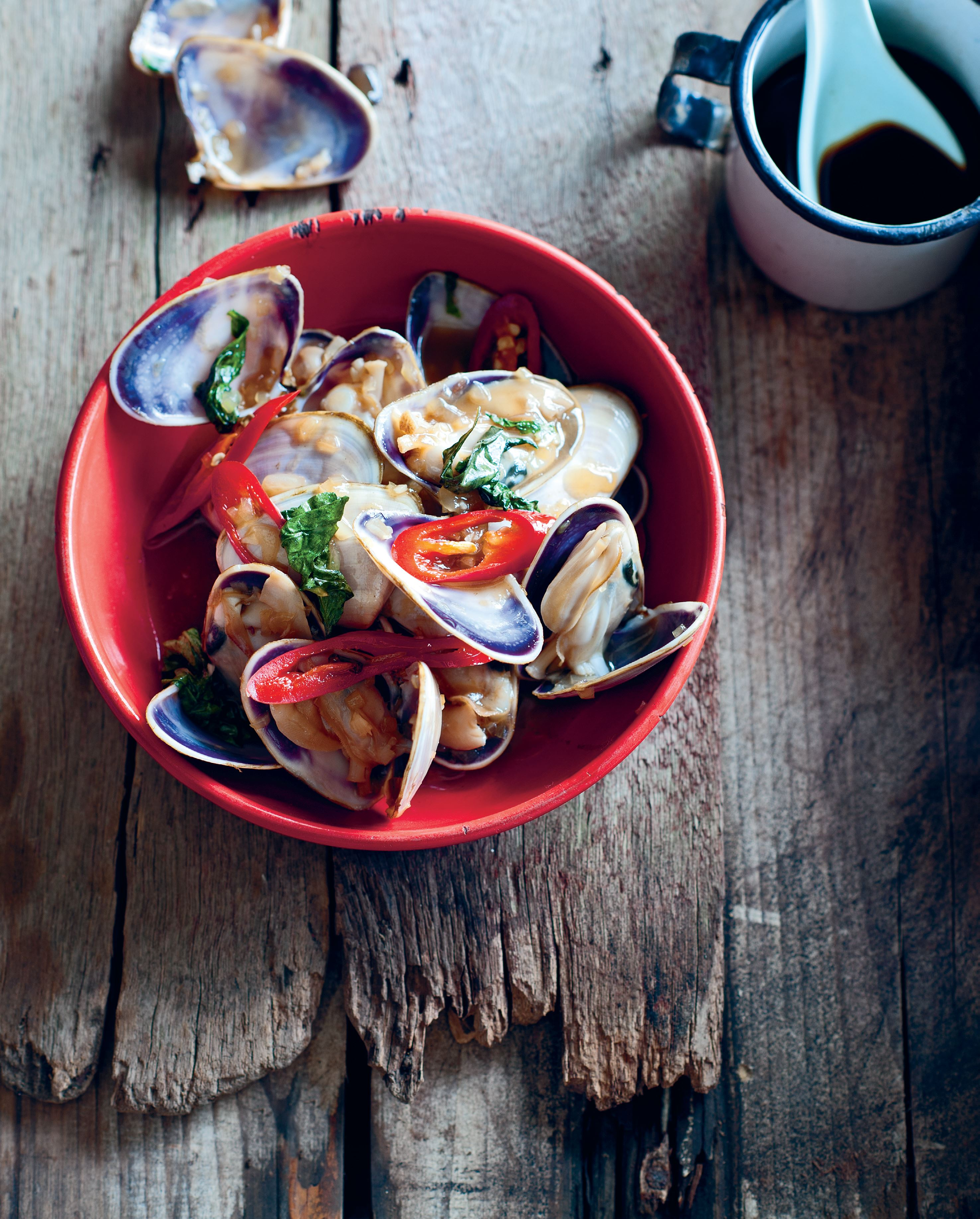 Pipis wok-tossed with chilli and Asian basil