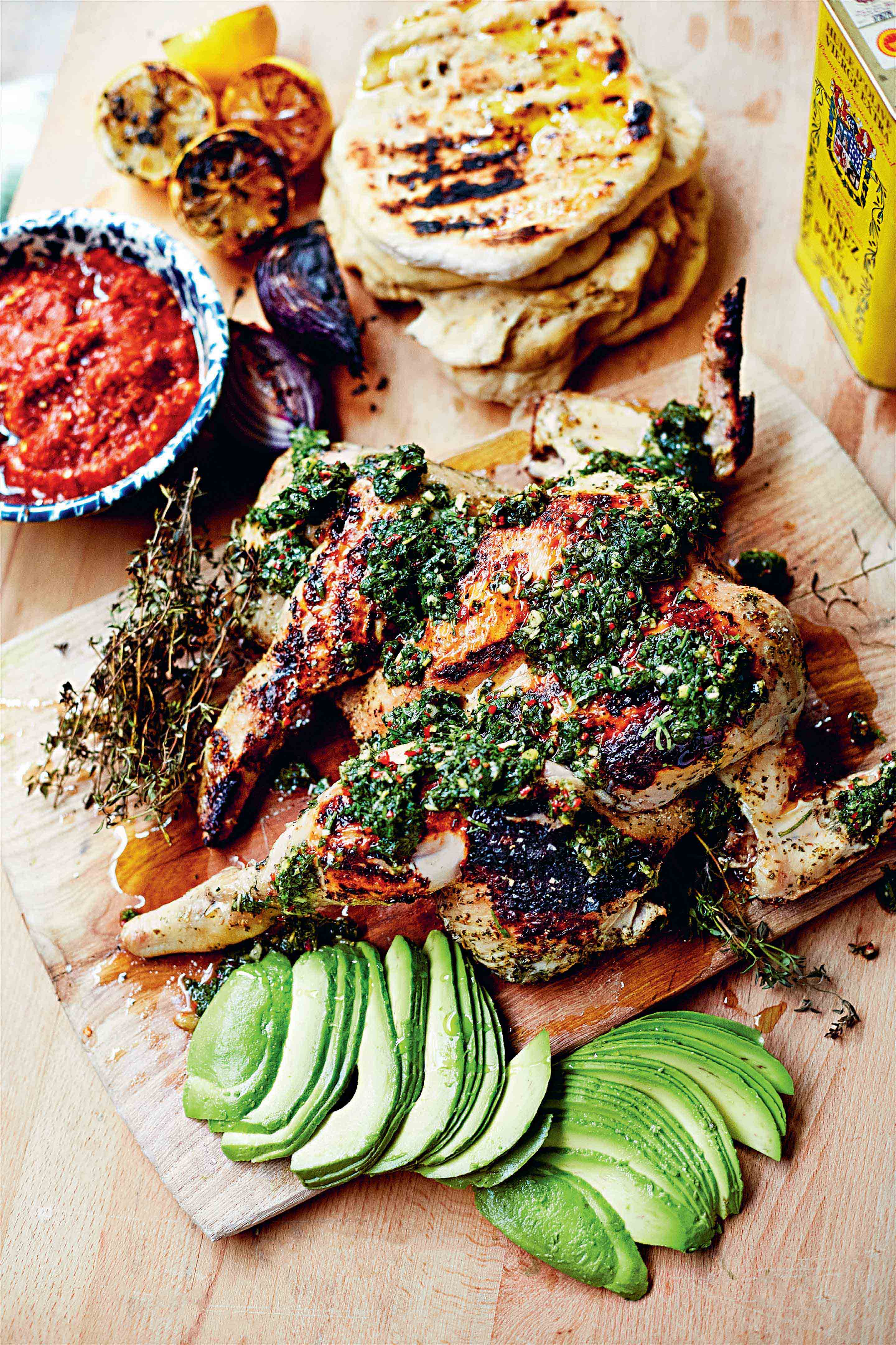 Spatchcock chicken with yoghurt, chermoula, avocado & chile de árbol