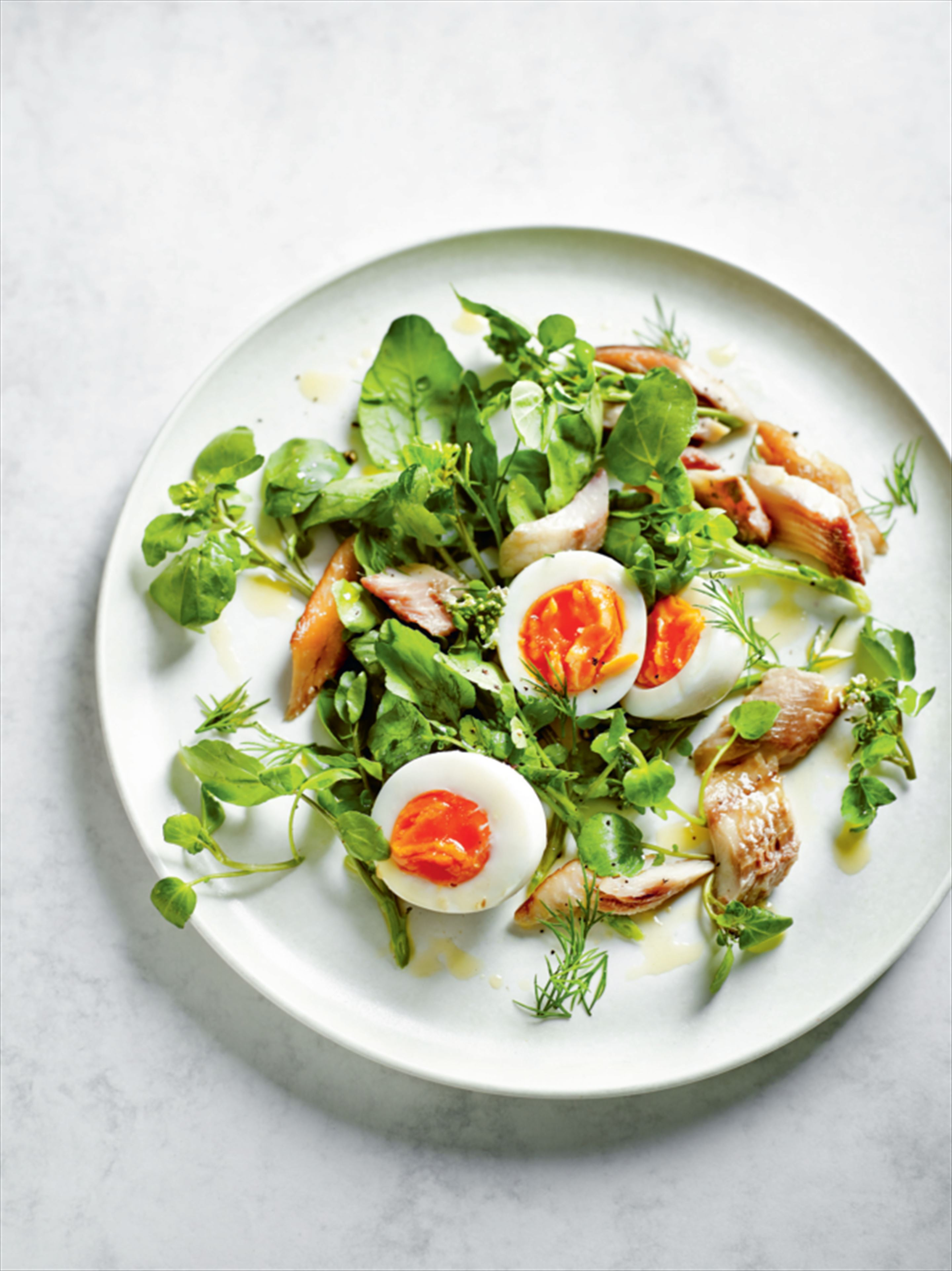 Kippers, boiled egg and watercress salad