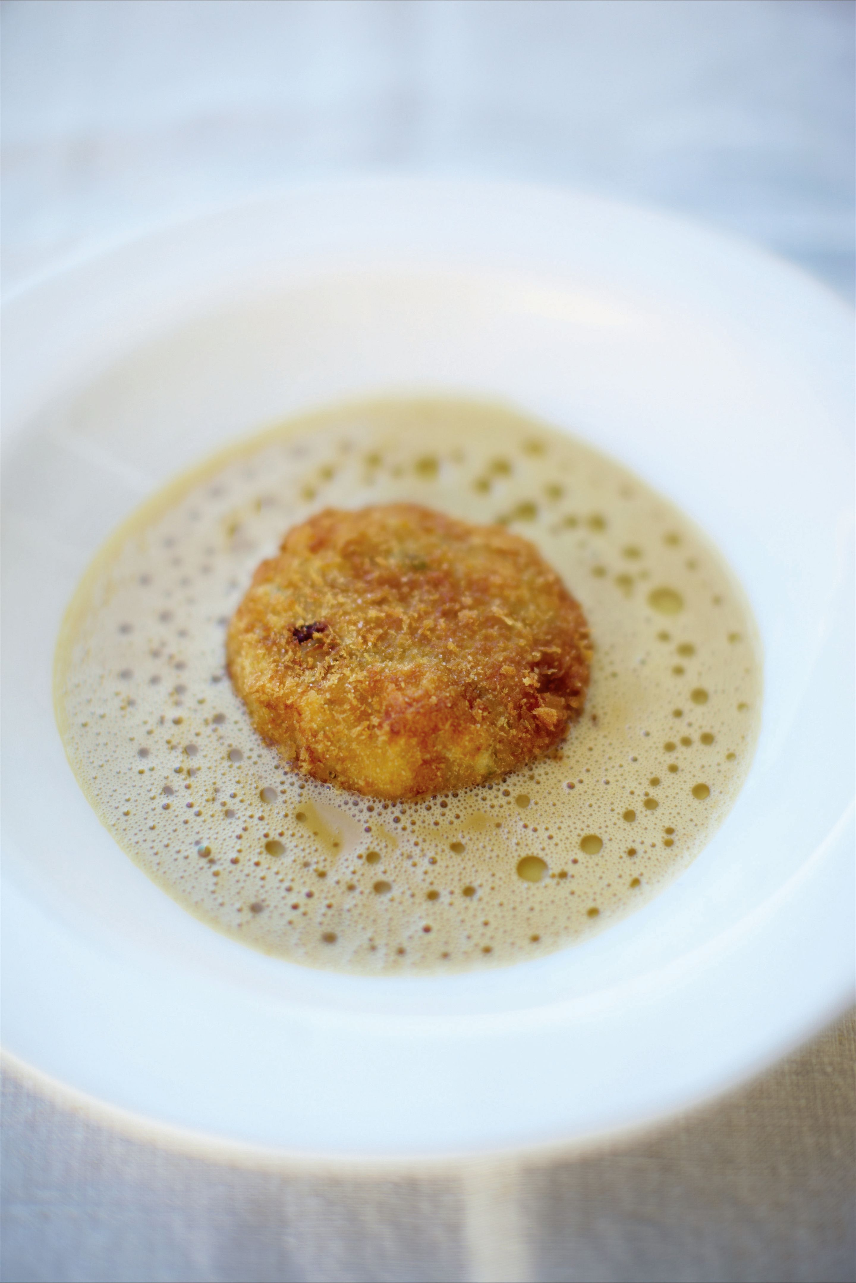 Velvet crab soup with crispy crab cakes