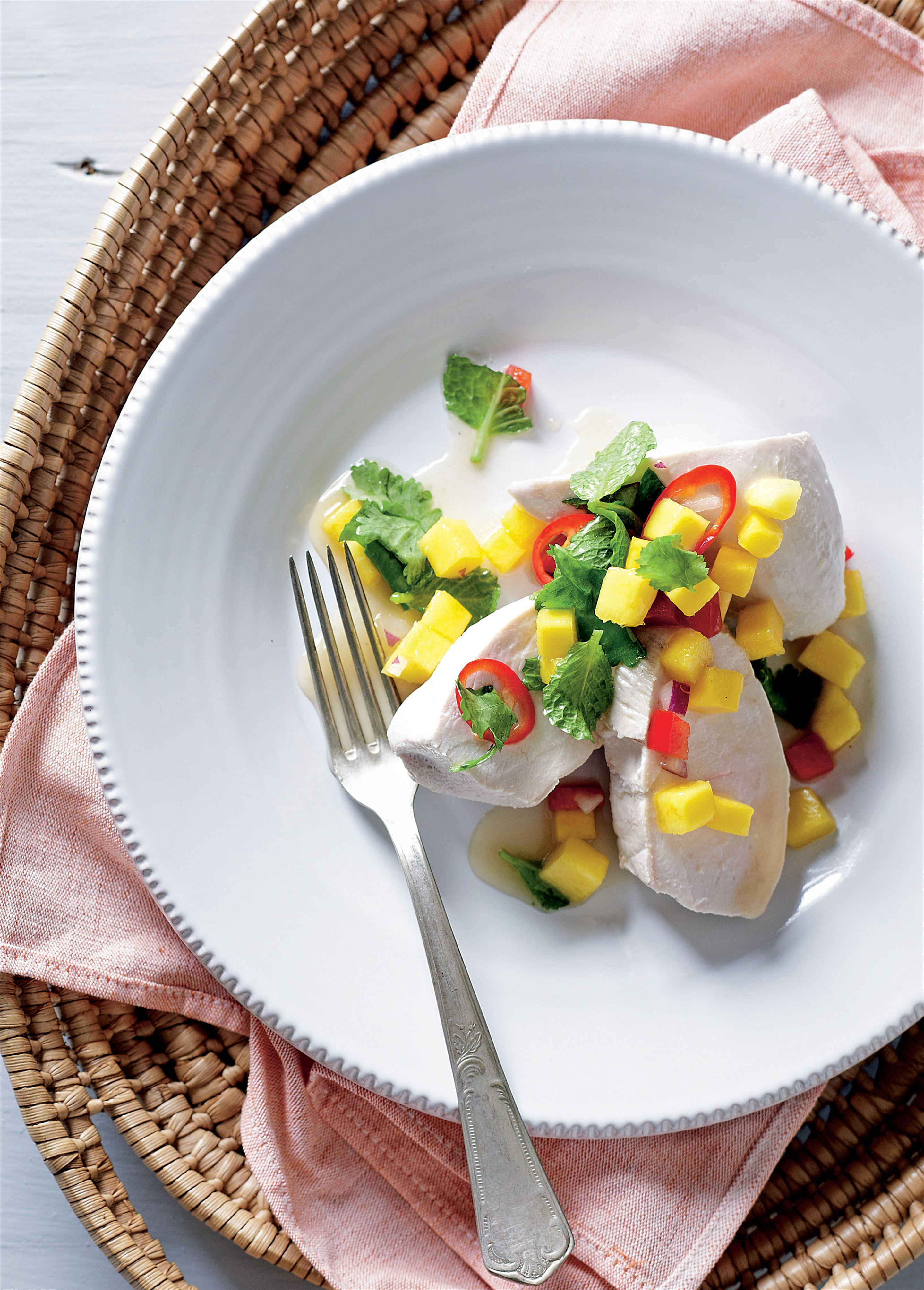 Poached chicken with mango salsa