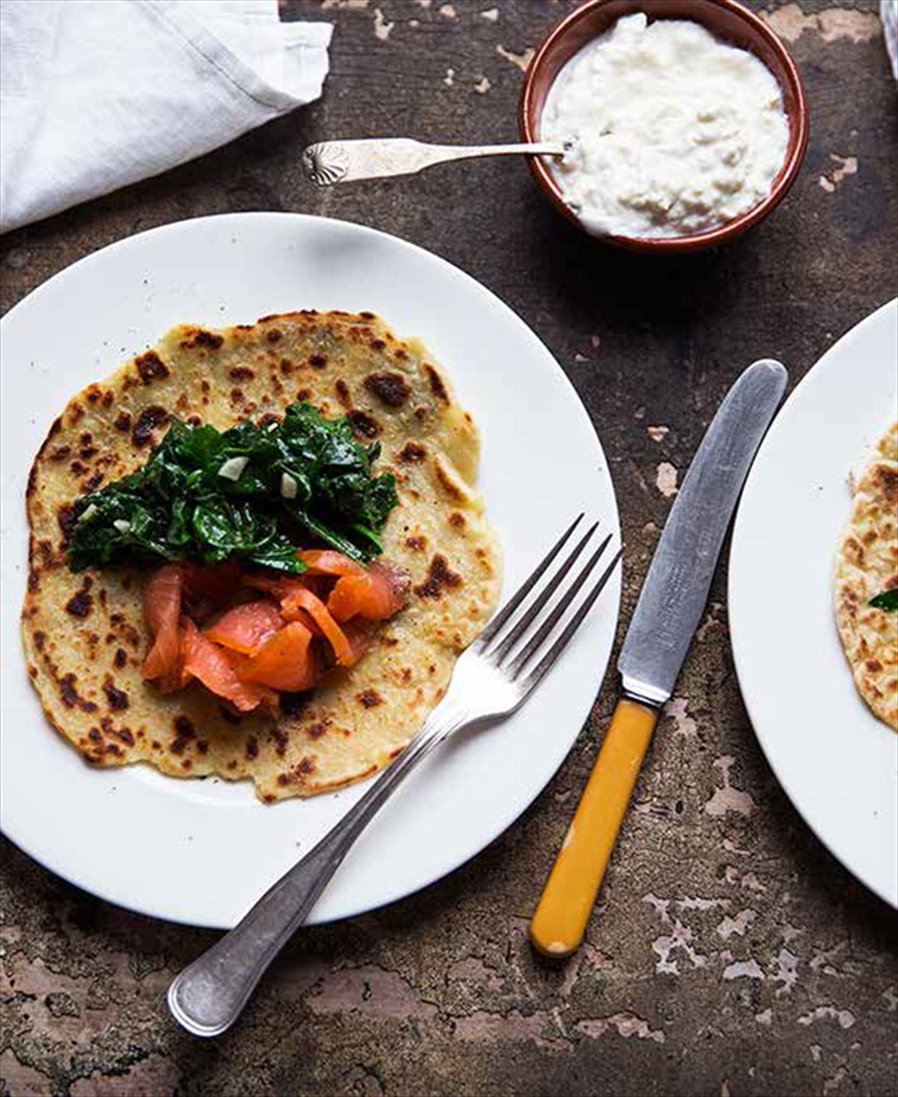 Norwegian potato pancakes with salmon and spinach