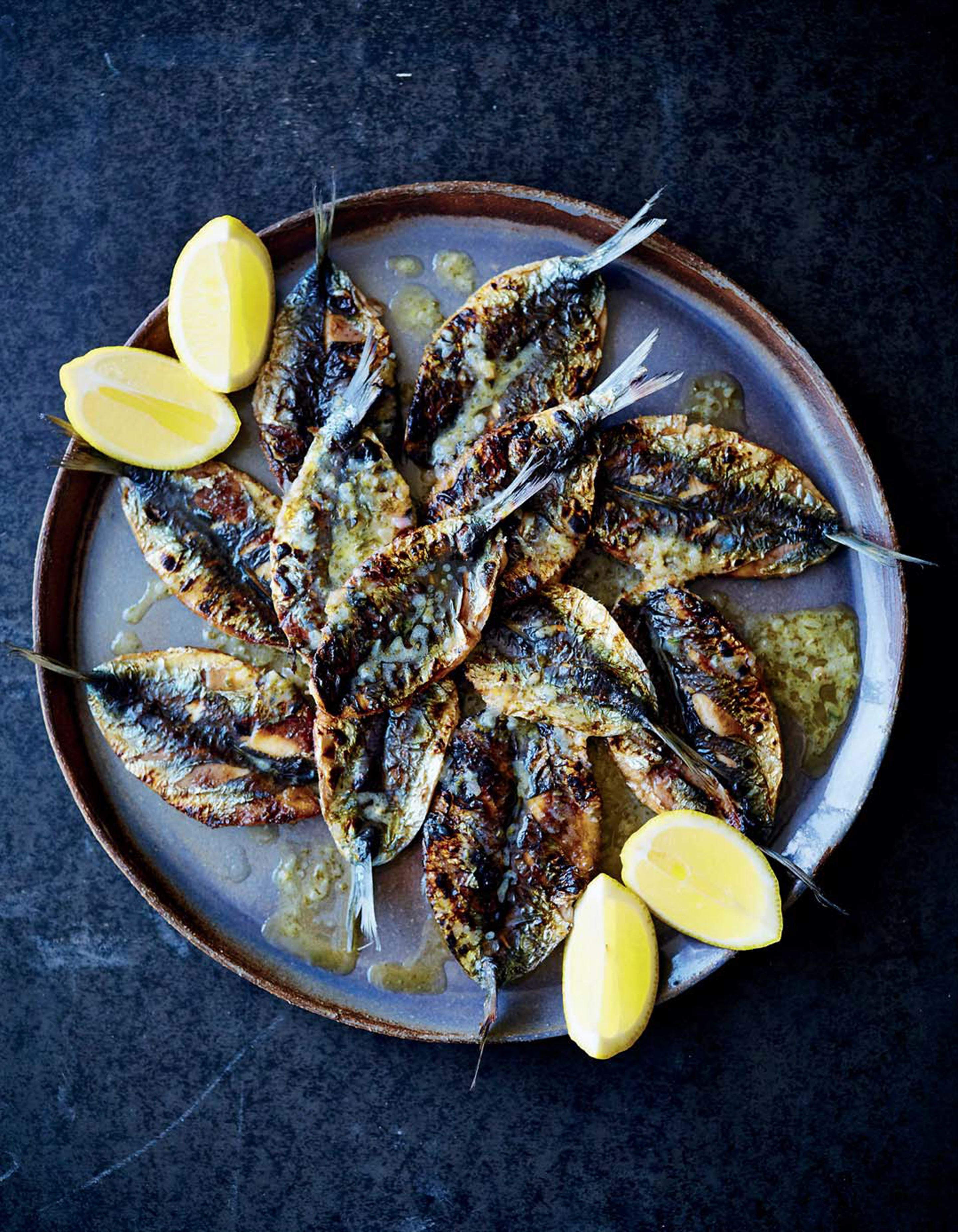 Barbecued sardines with parsley, roast garlic and lemon butter