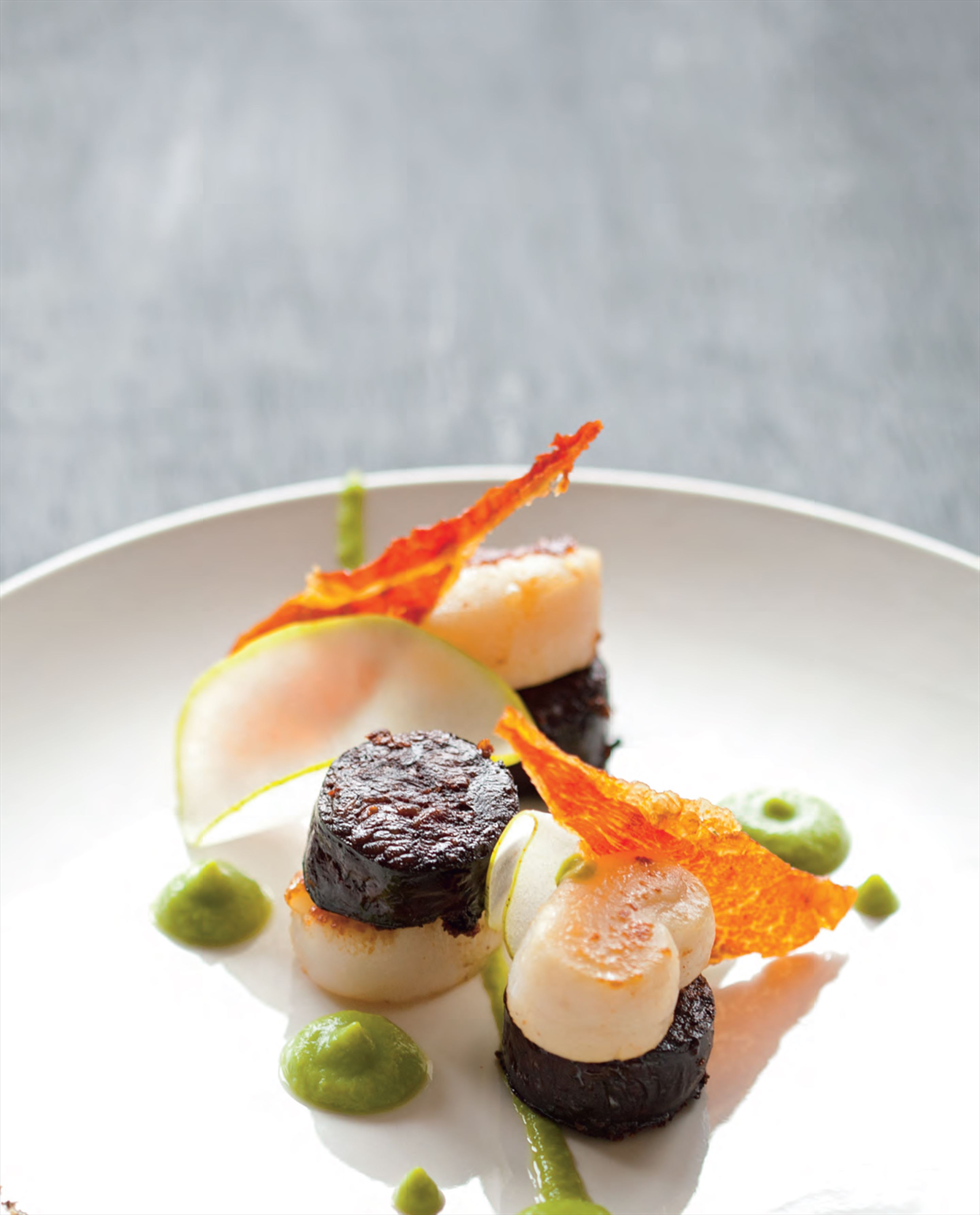 Seared scallops and black pudding with pea purée