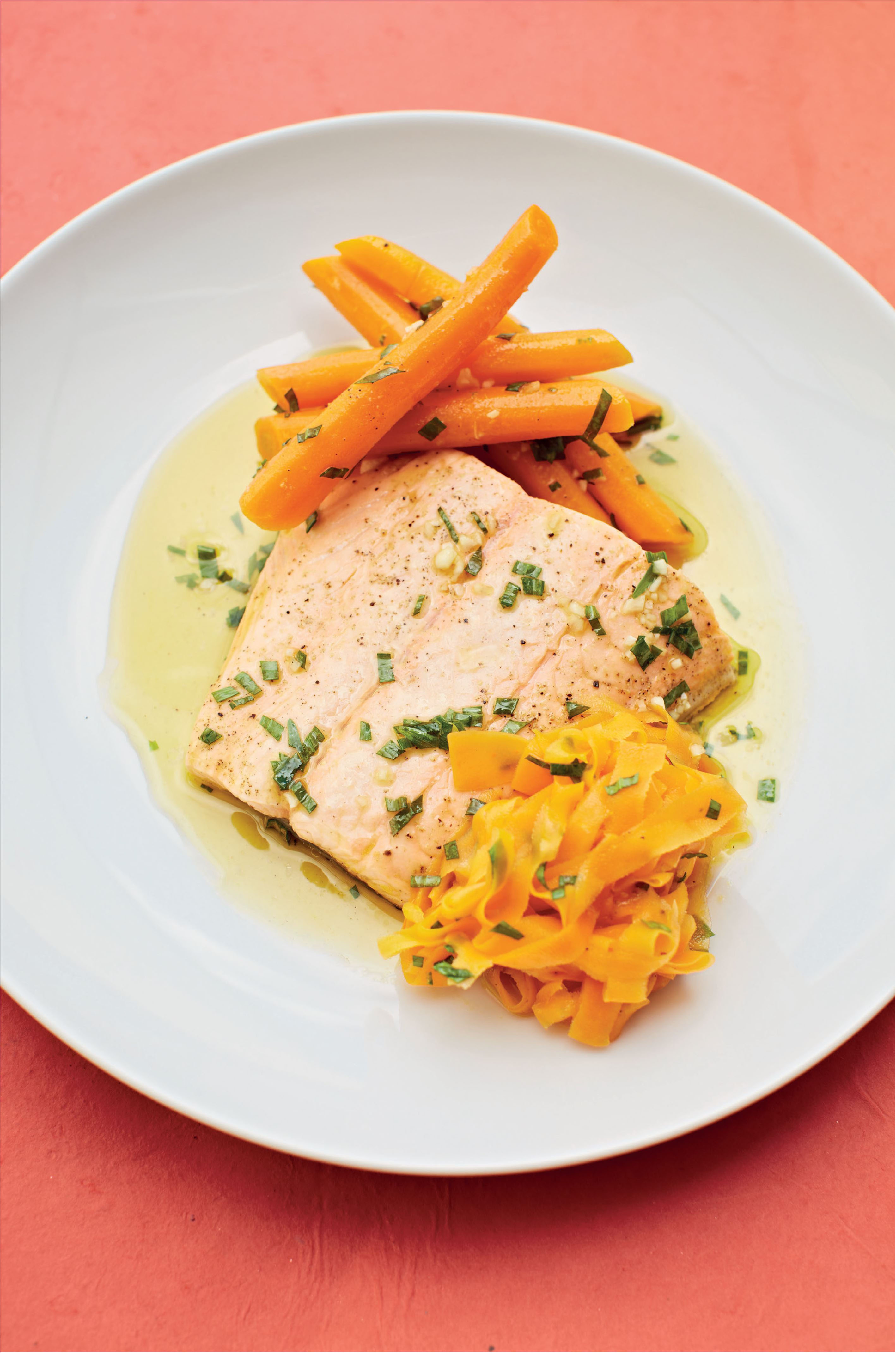 Salmon poached in tarragon vinegar with carrots in brown butter