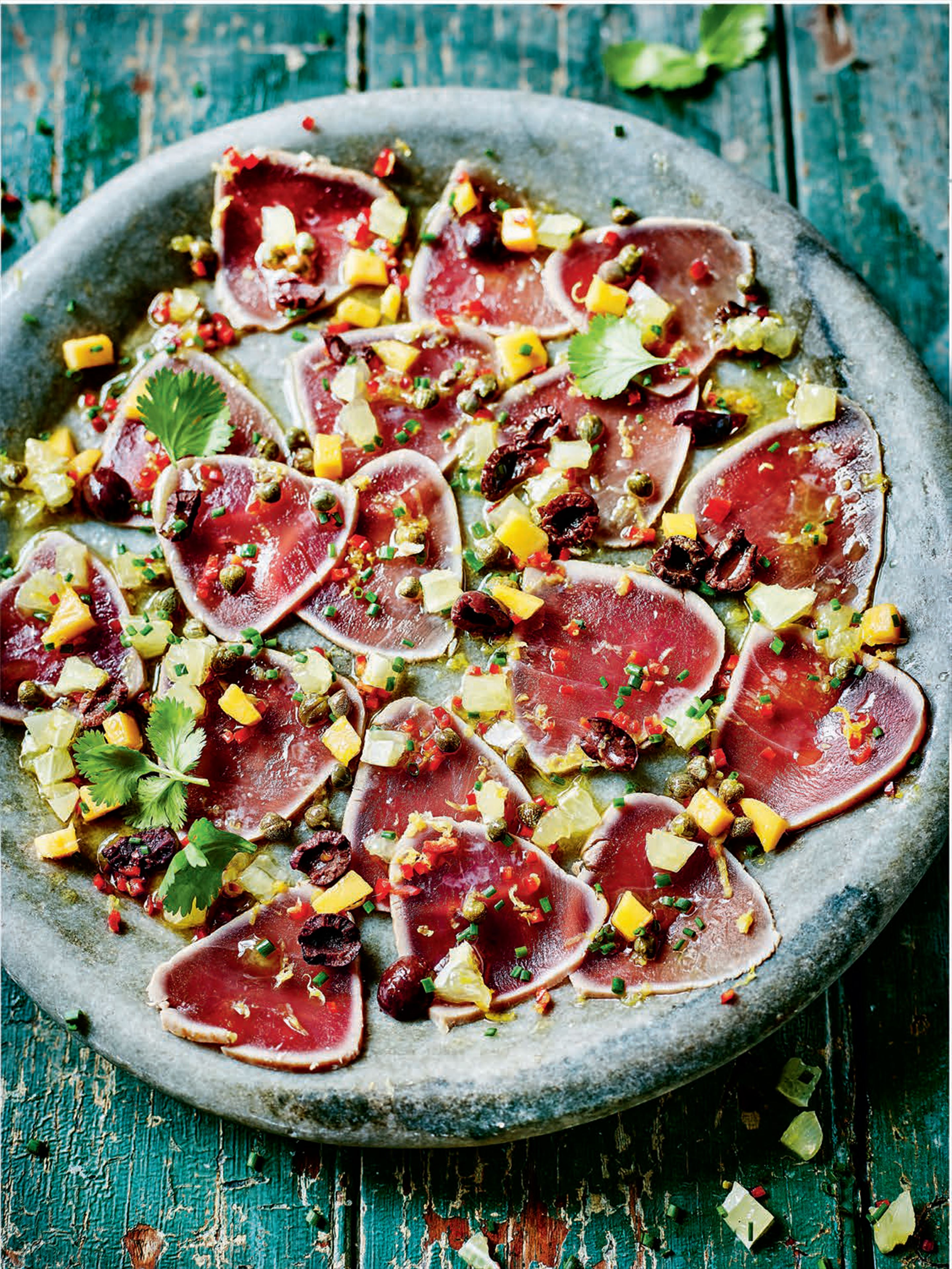 Tuna carpaccio with olive, mango and caper dressing