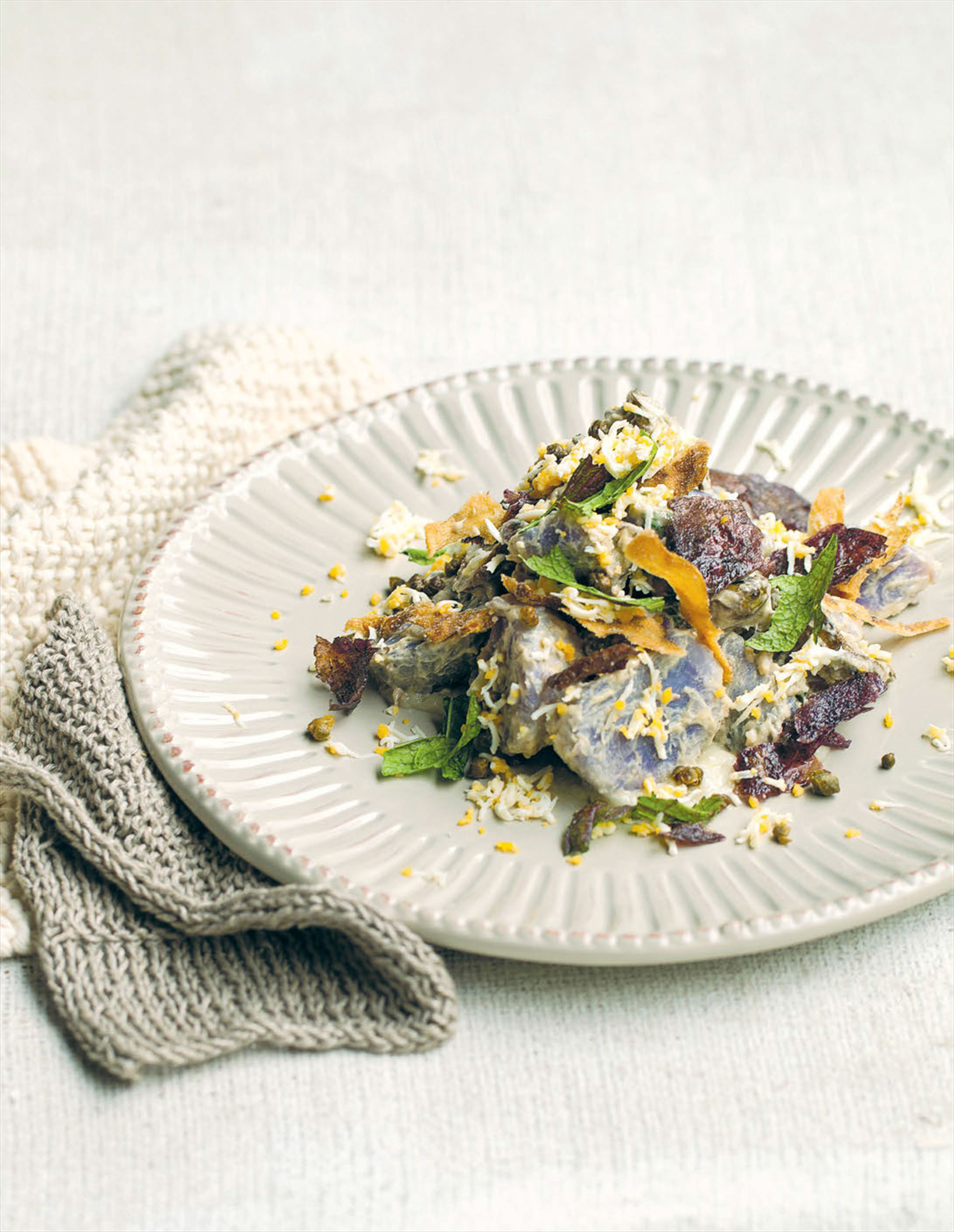 Purple congo potatoes, sunchokes and anchovy dressing