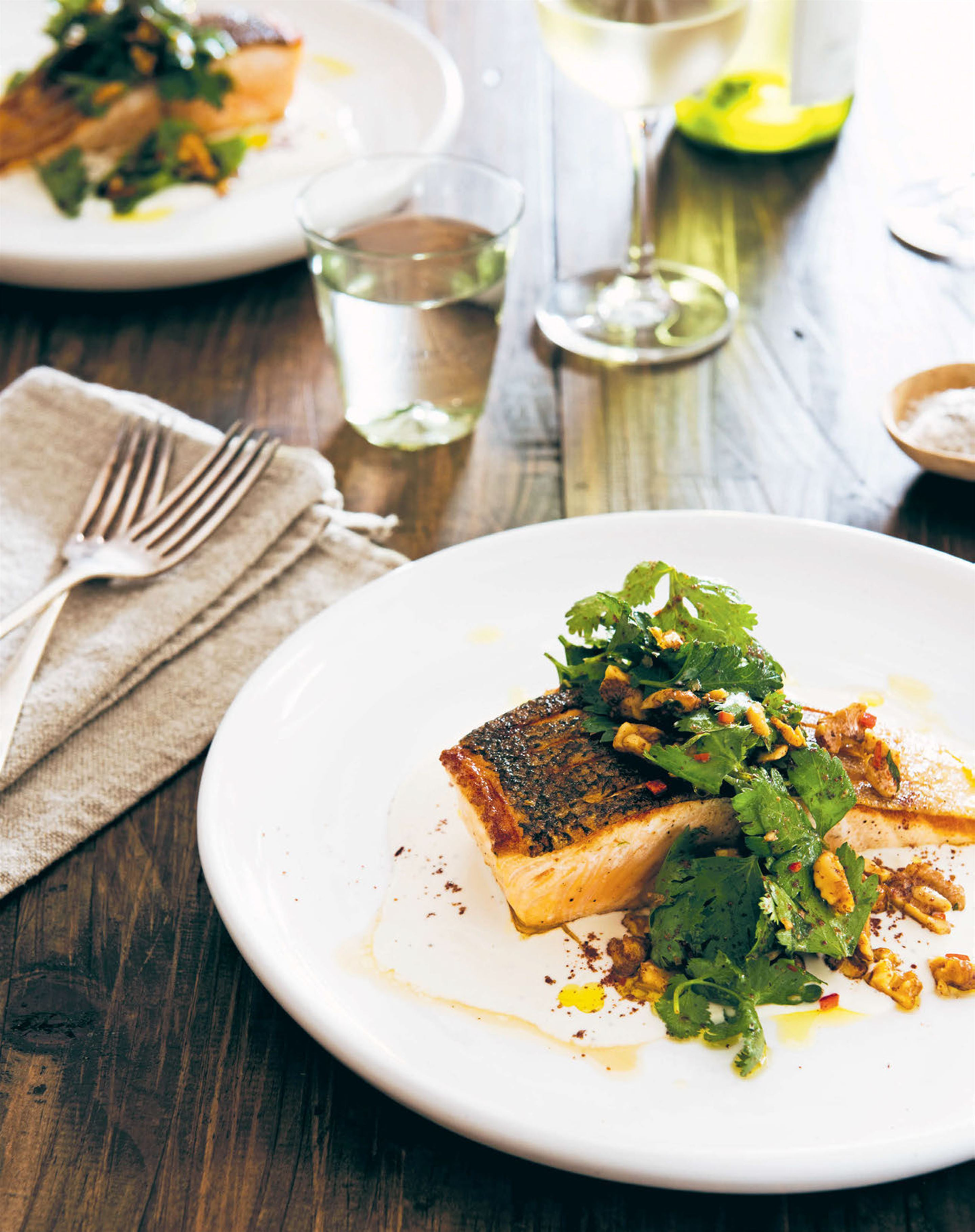 Pan-fried salmon with tahini dressing & walnut tarator