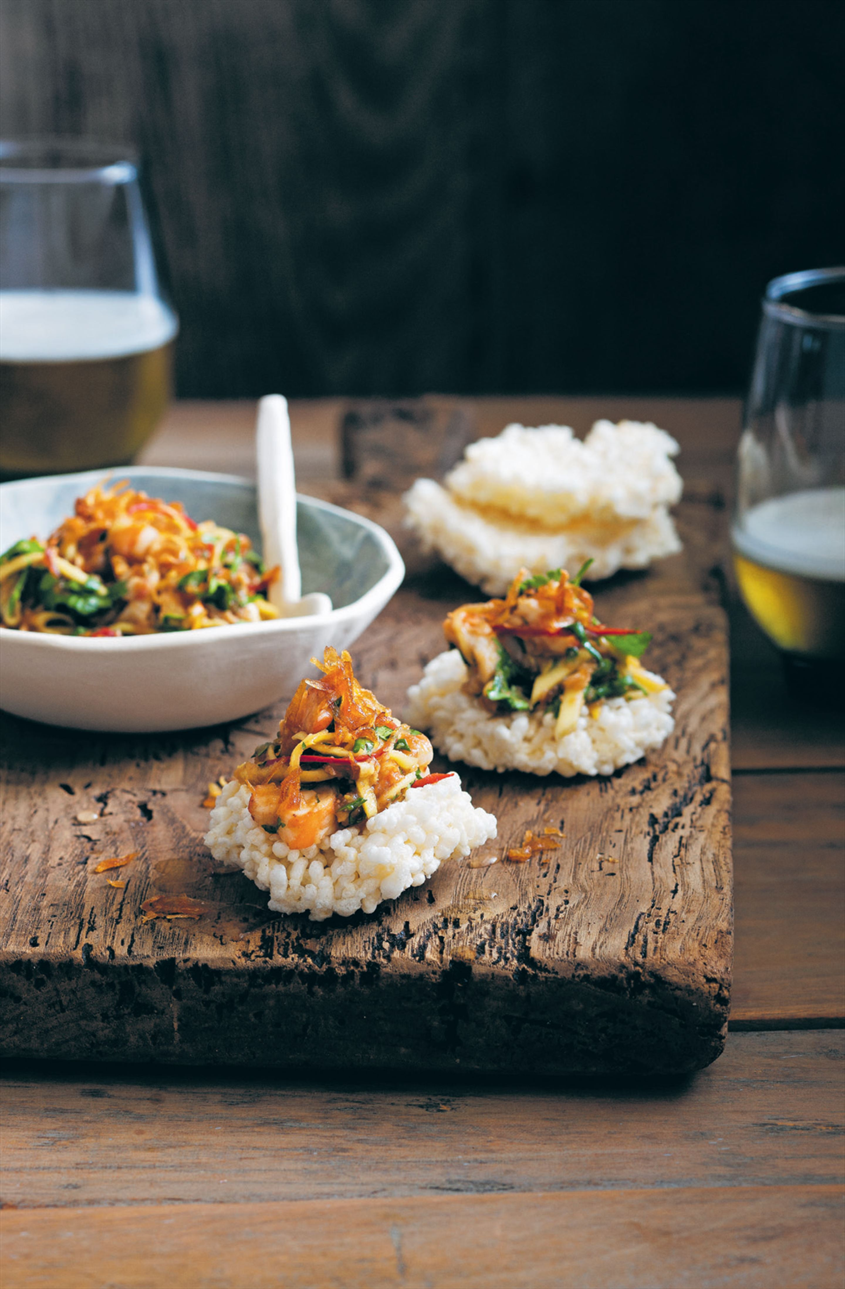 Prawn and green mango relish with rice cakes