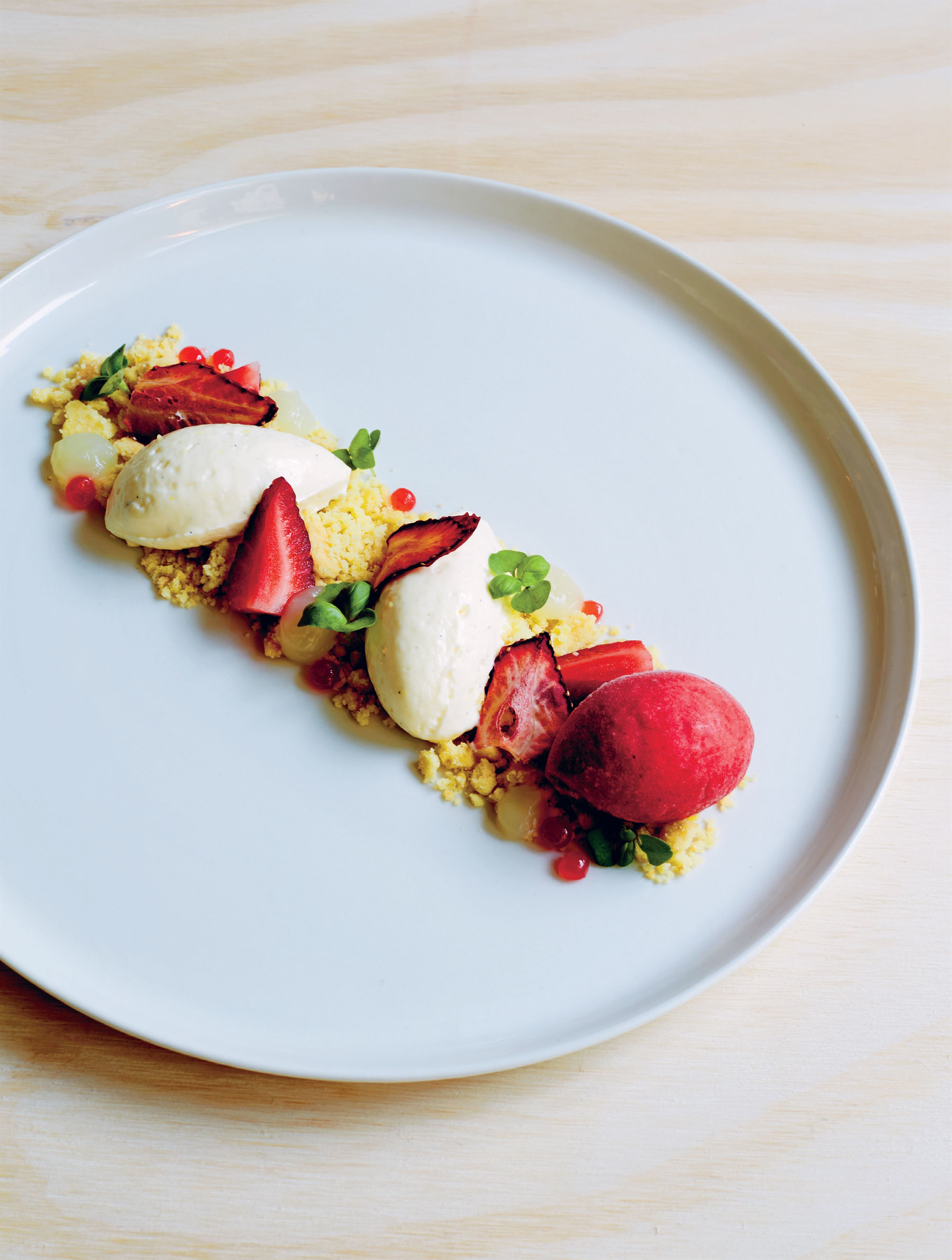 Crème fraîche cheesecake with strawberries, citrus crumbs & strawberry sorbet