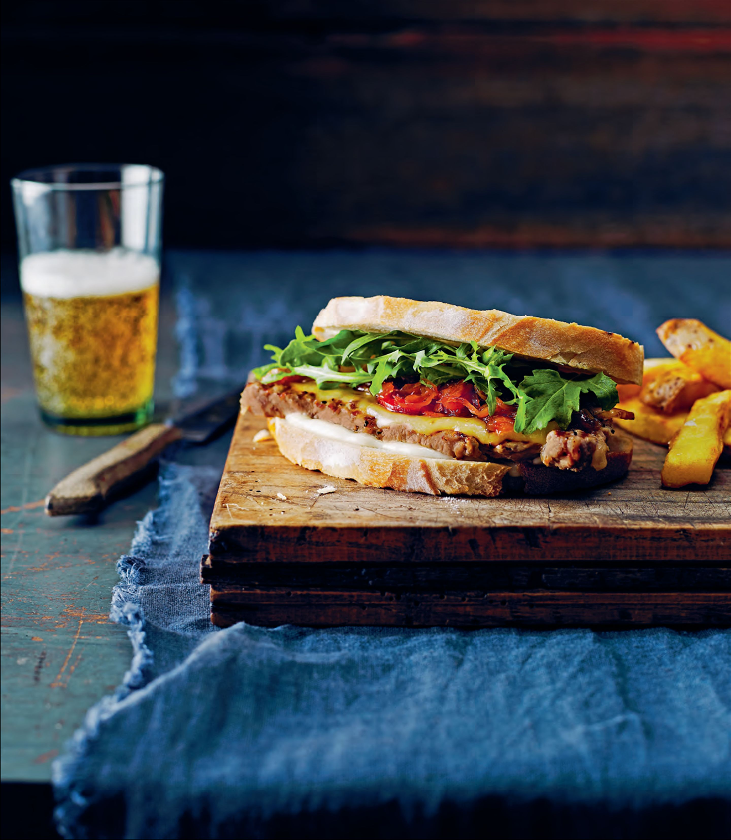 Steak sandwiches with caramelised onion, smoked cheddar and bacon