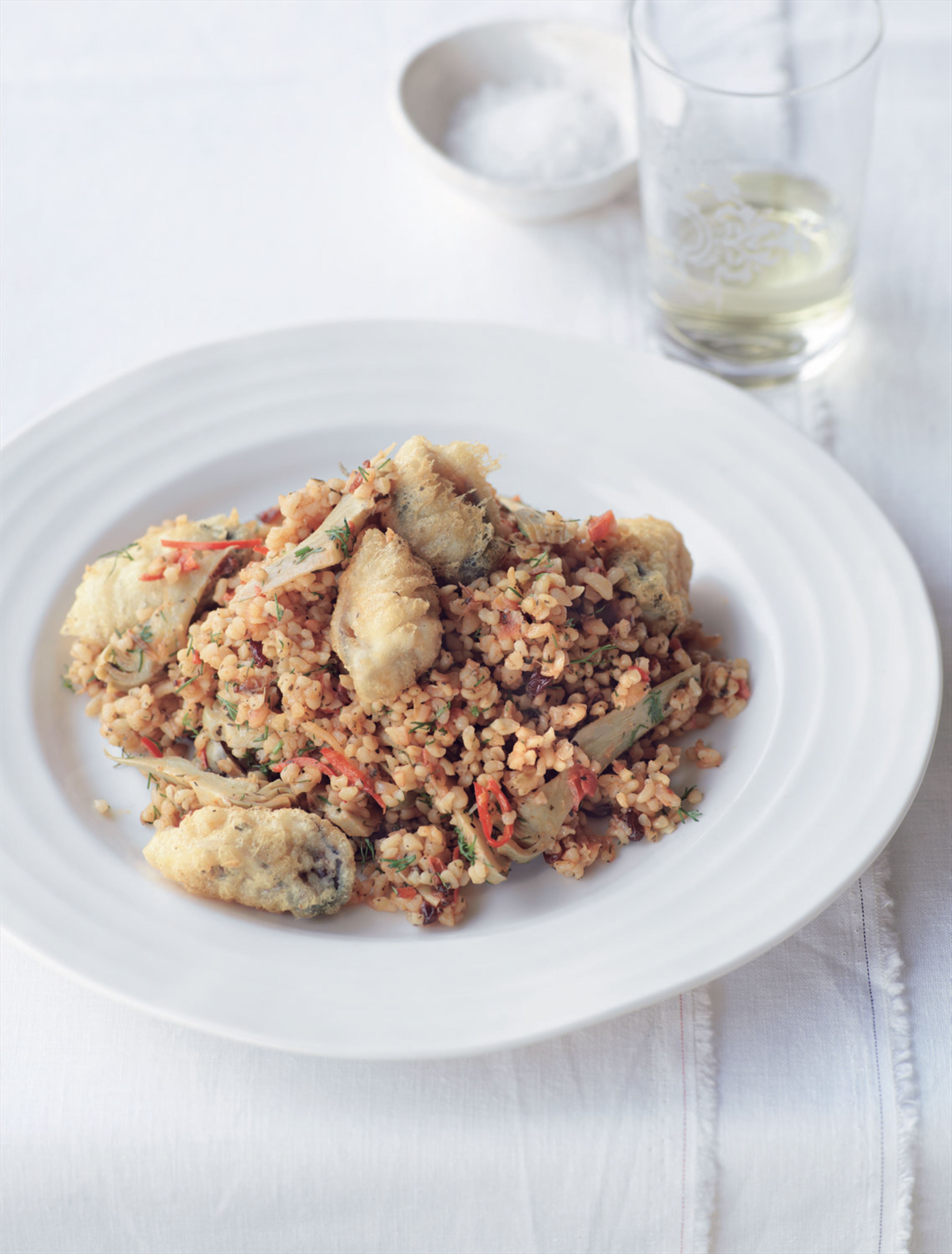 Artichoke and barberry bulgur pilav with fried mussels