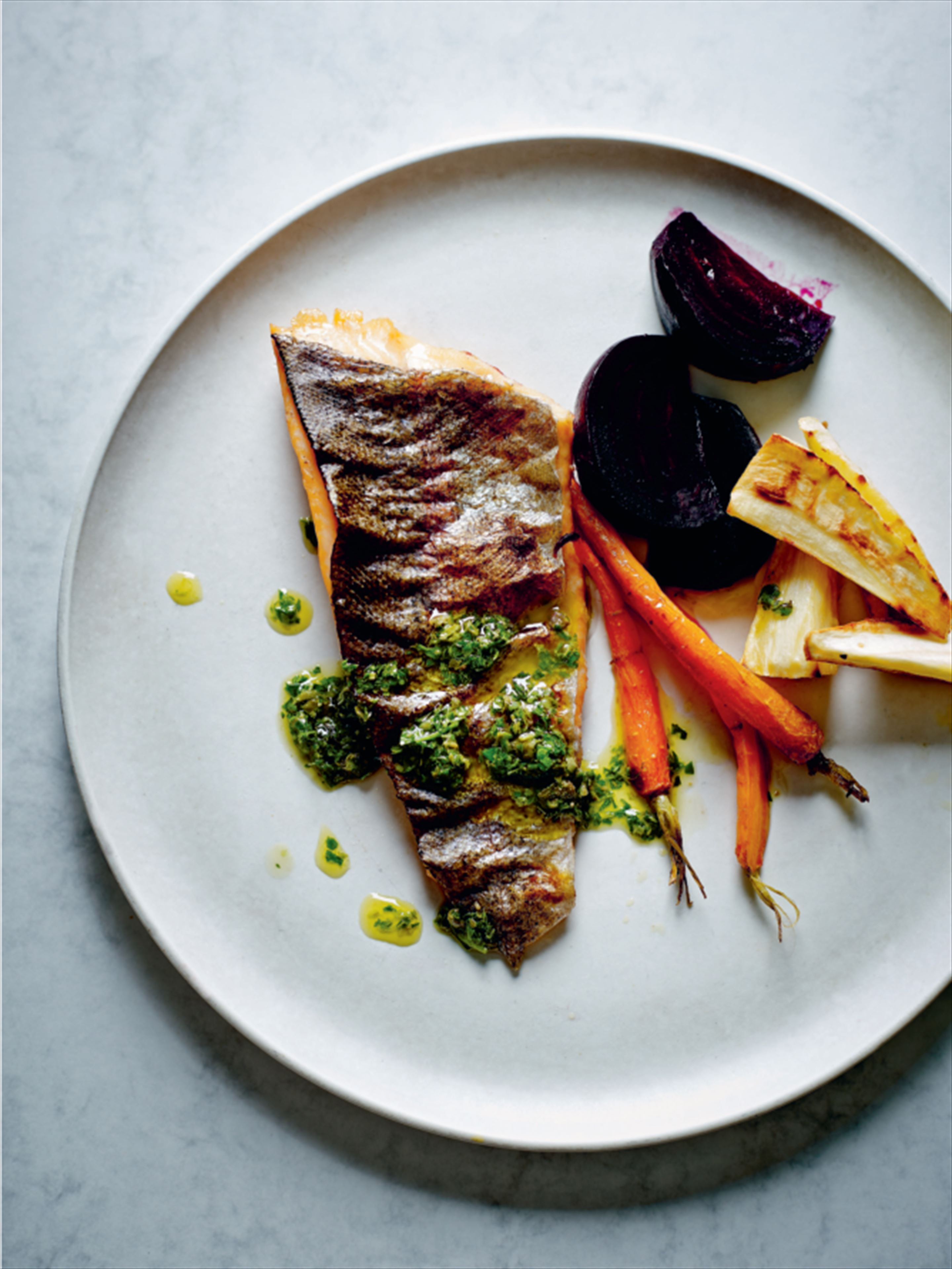 Grilled trout with root vegetables and salsa verde