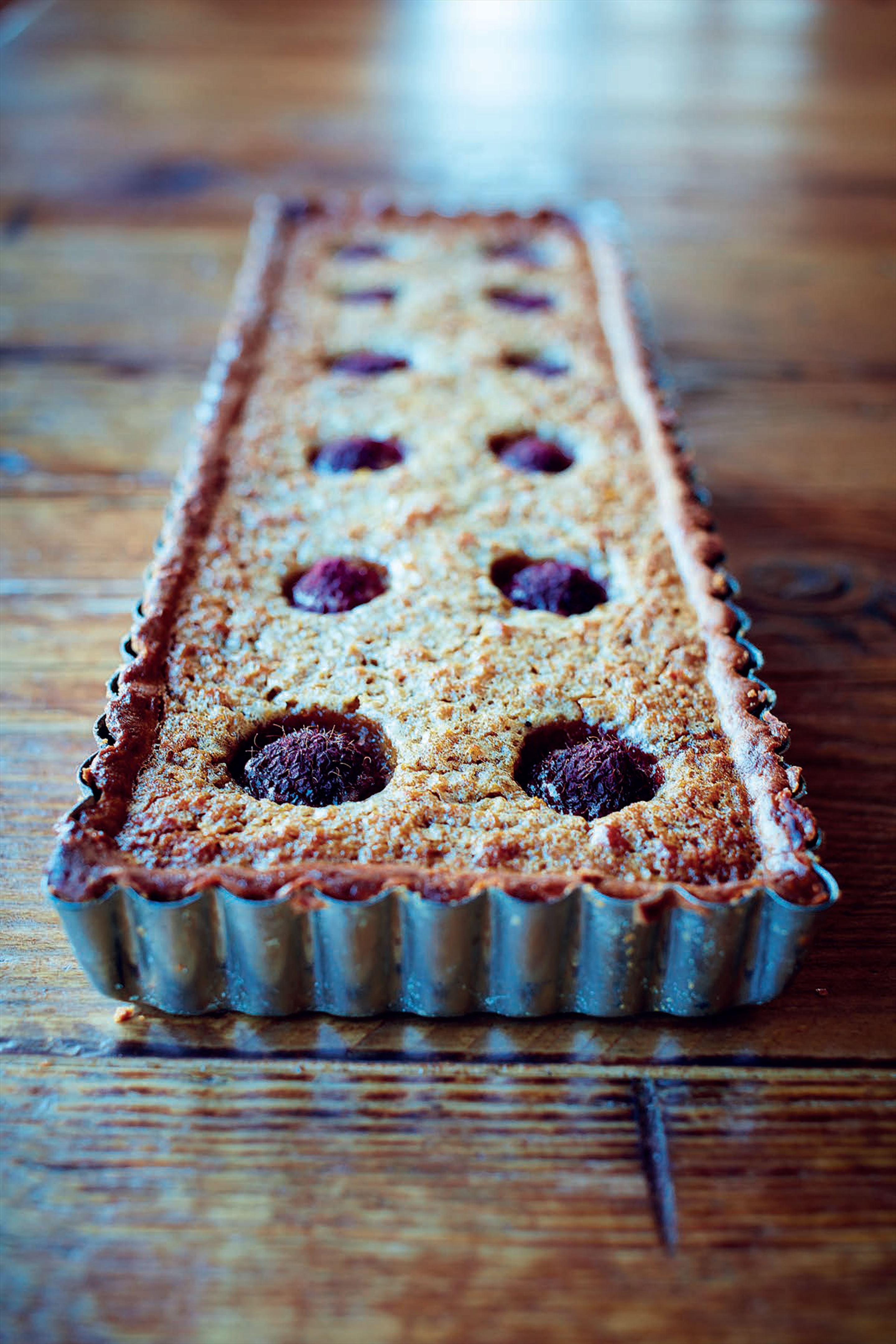 Treacle and raspberry tart