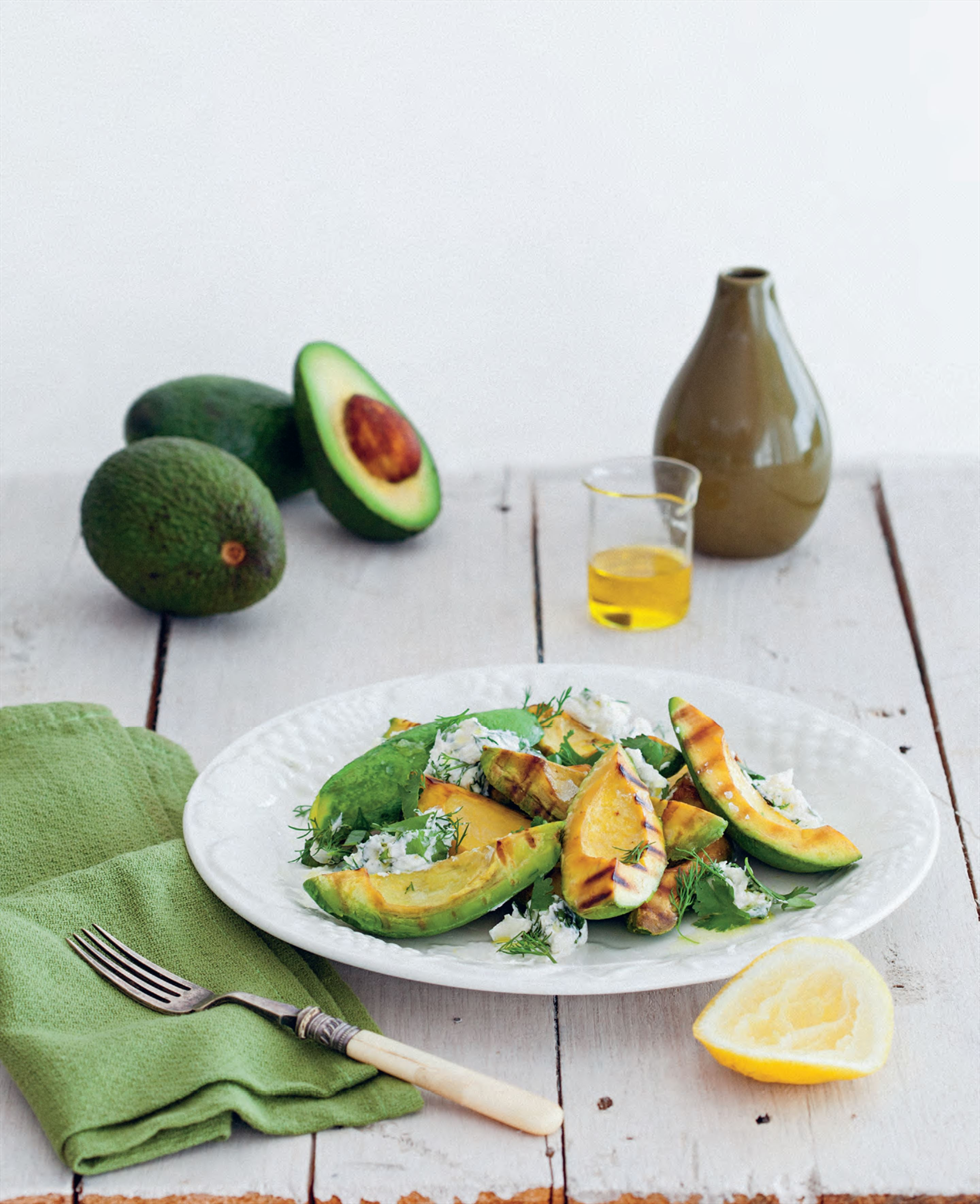 Barbecued avocado with herb labneh salad