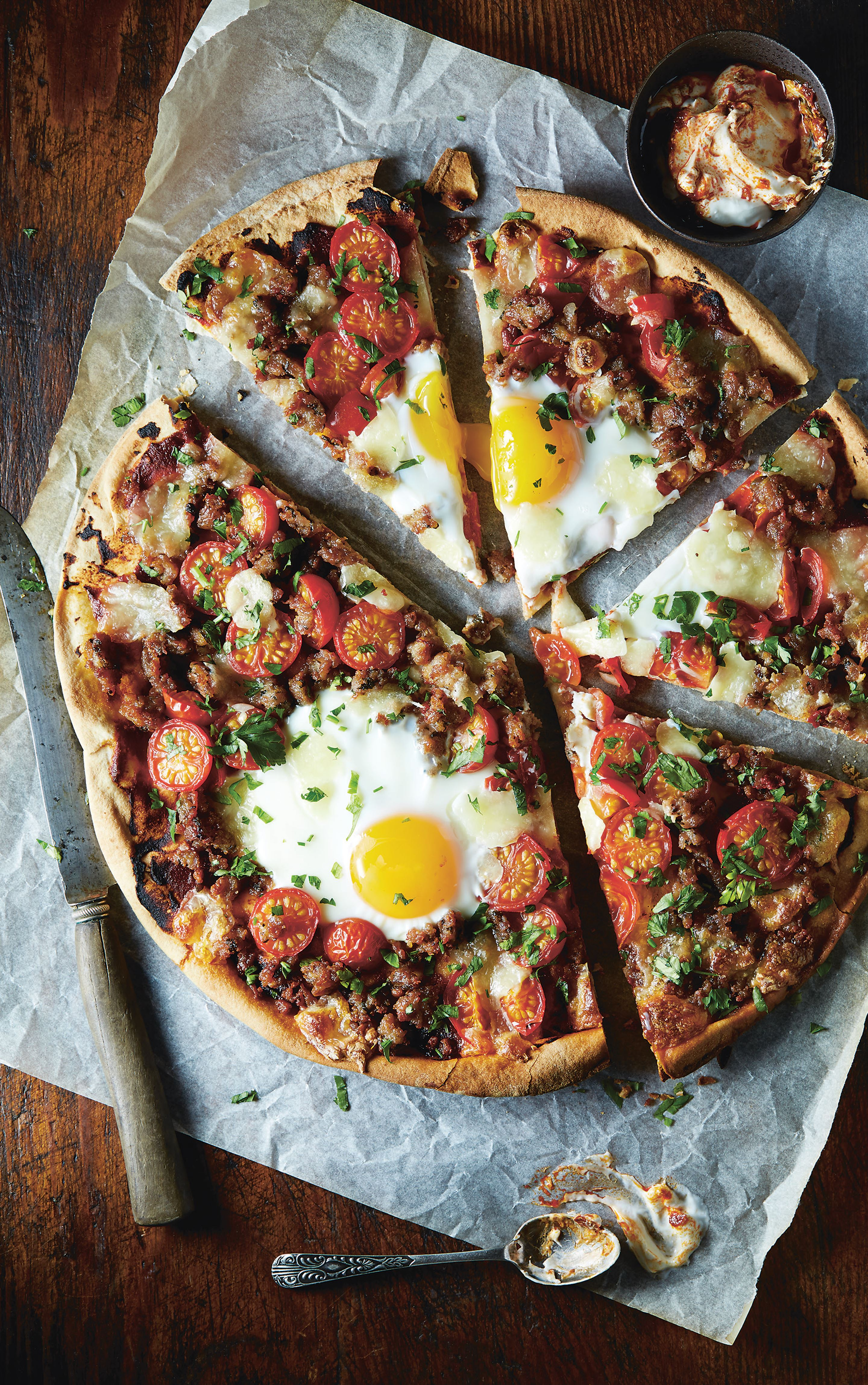 Sausage flatbread with egg and harissa yoghurt