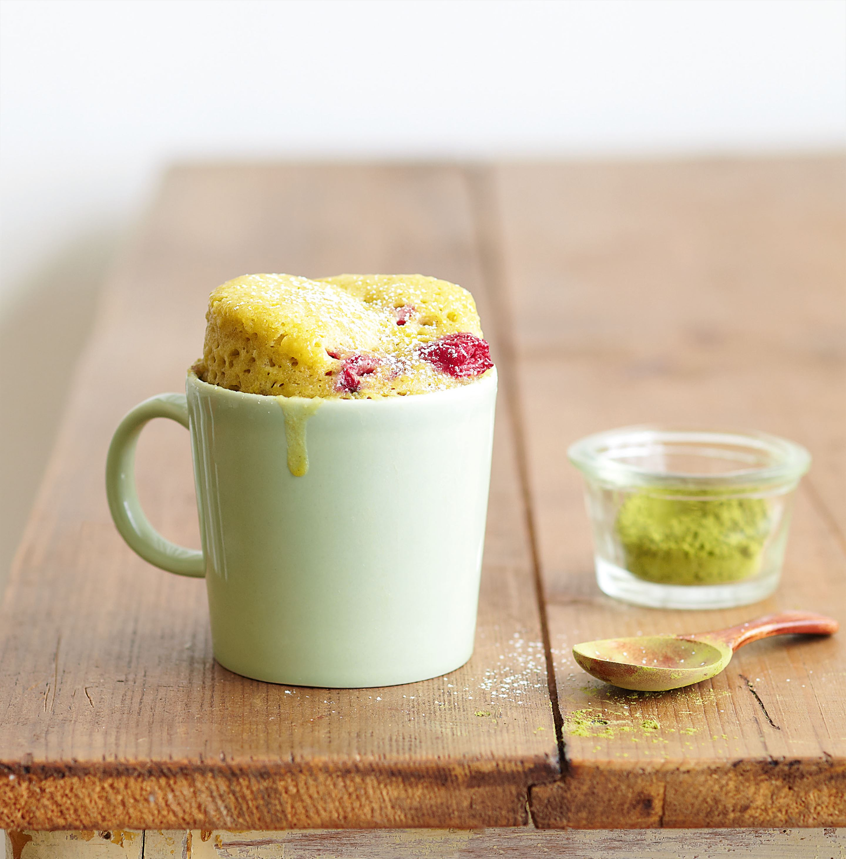 Green tea mug cake with raspberries
