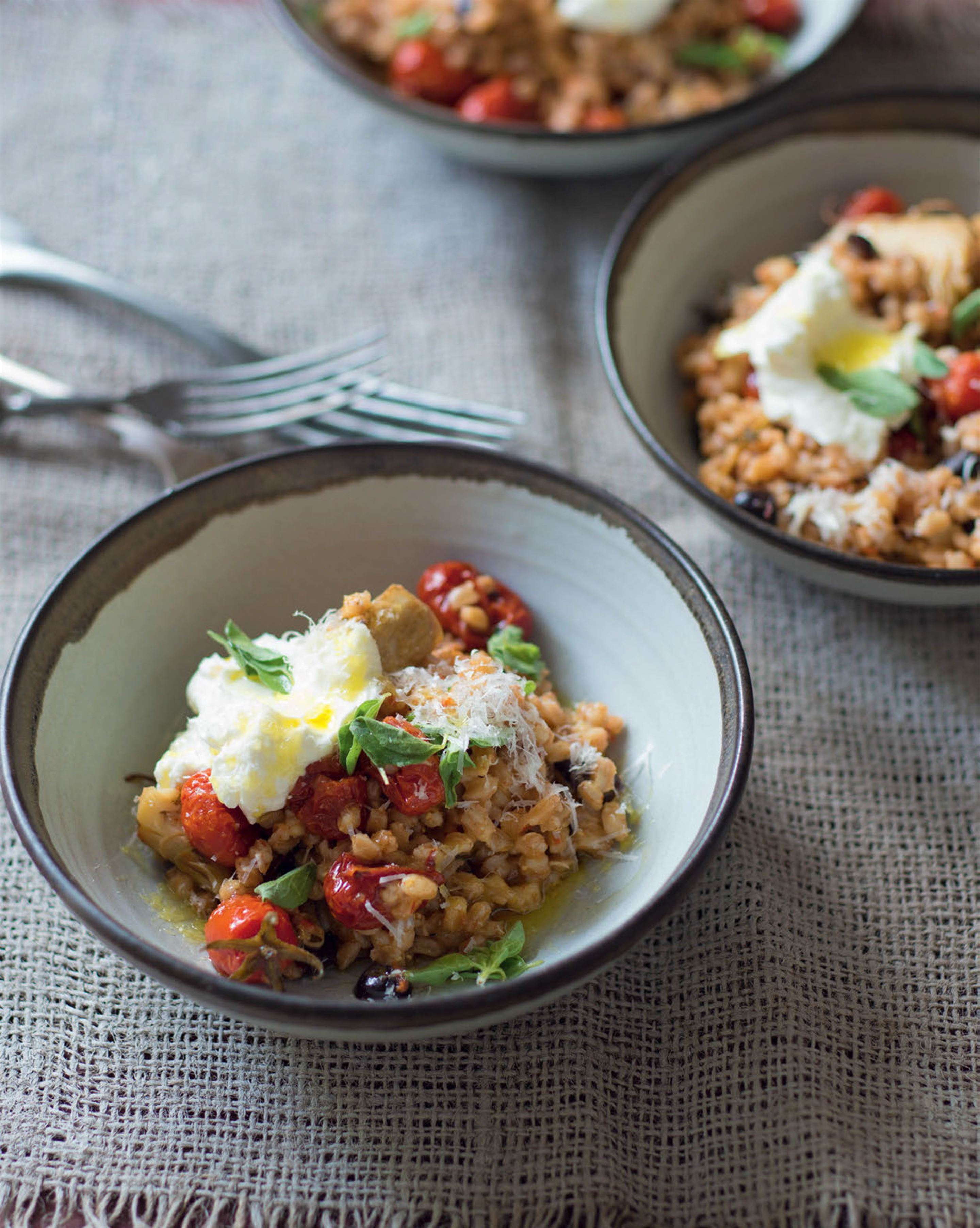 Farro with slow-roasted tomatoes, artichokes, olives & oregano