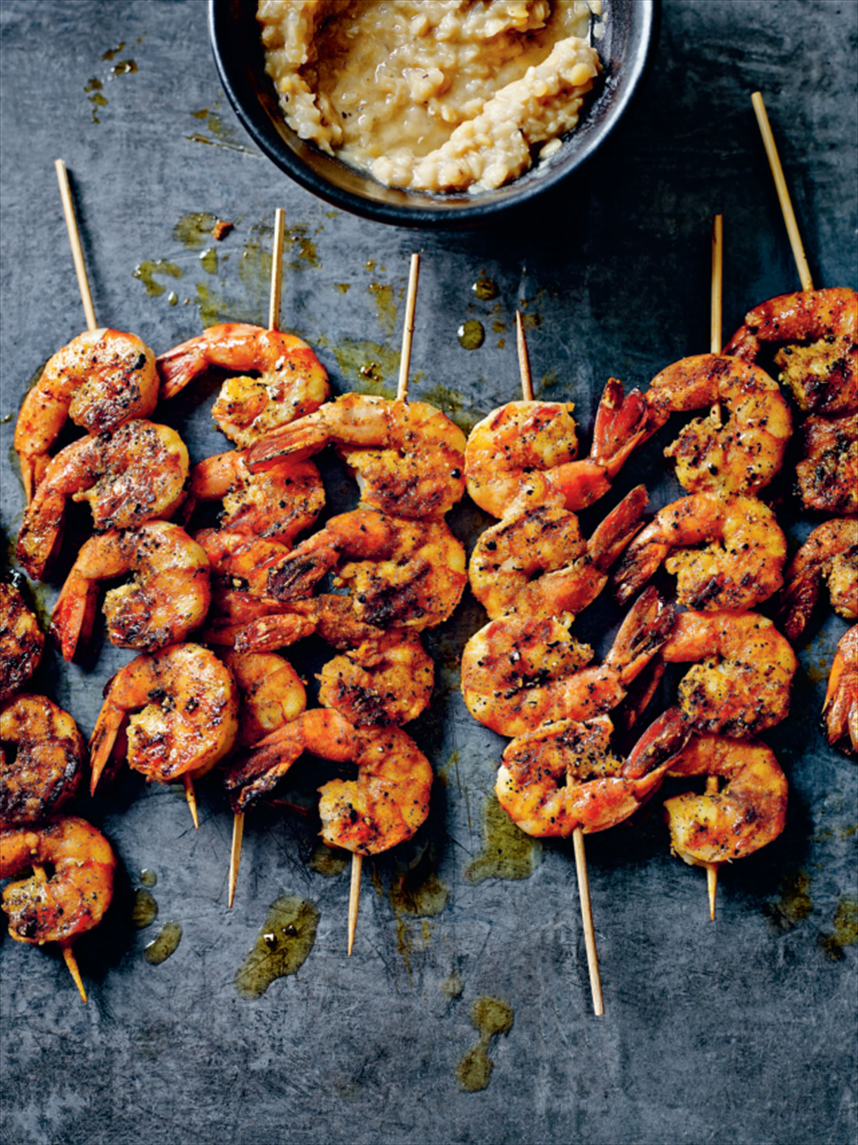 Peppered king prawn skewers with tarka dal