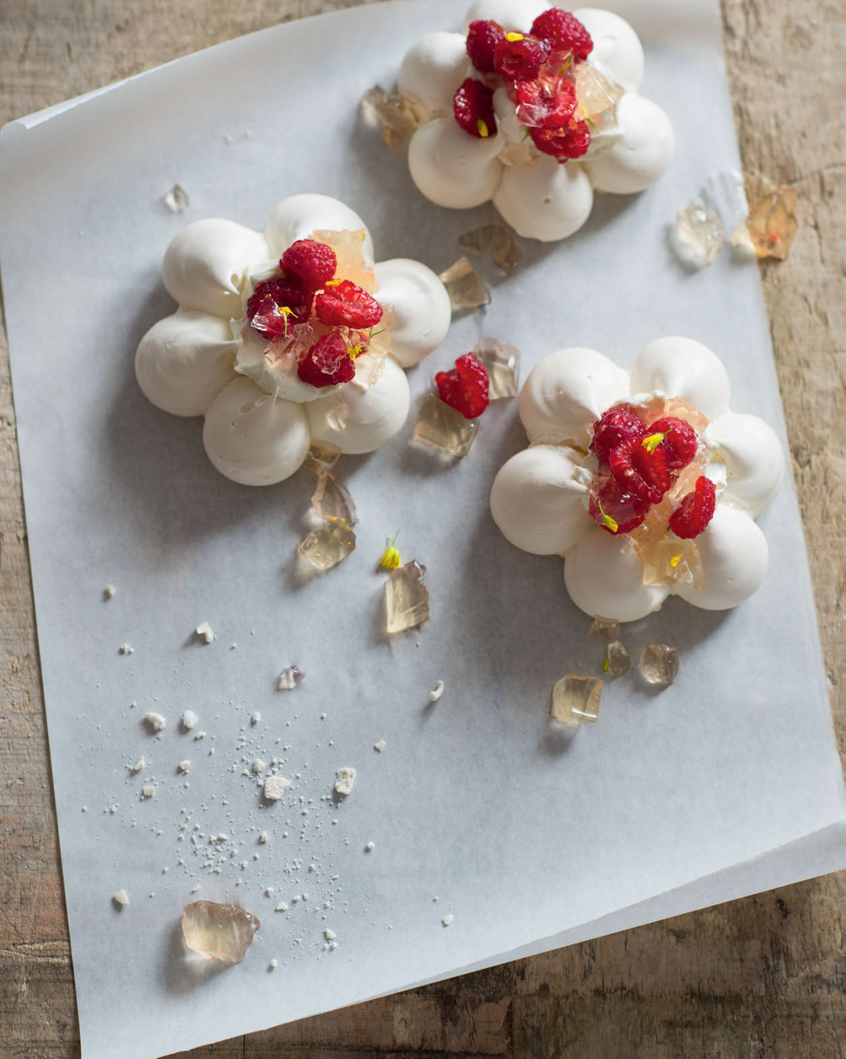 Pavlova 'flowers' with apple jelly, raspberries & vanilla labneh