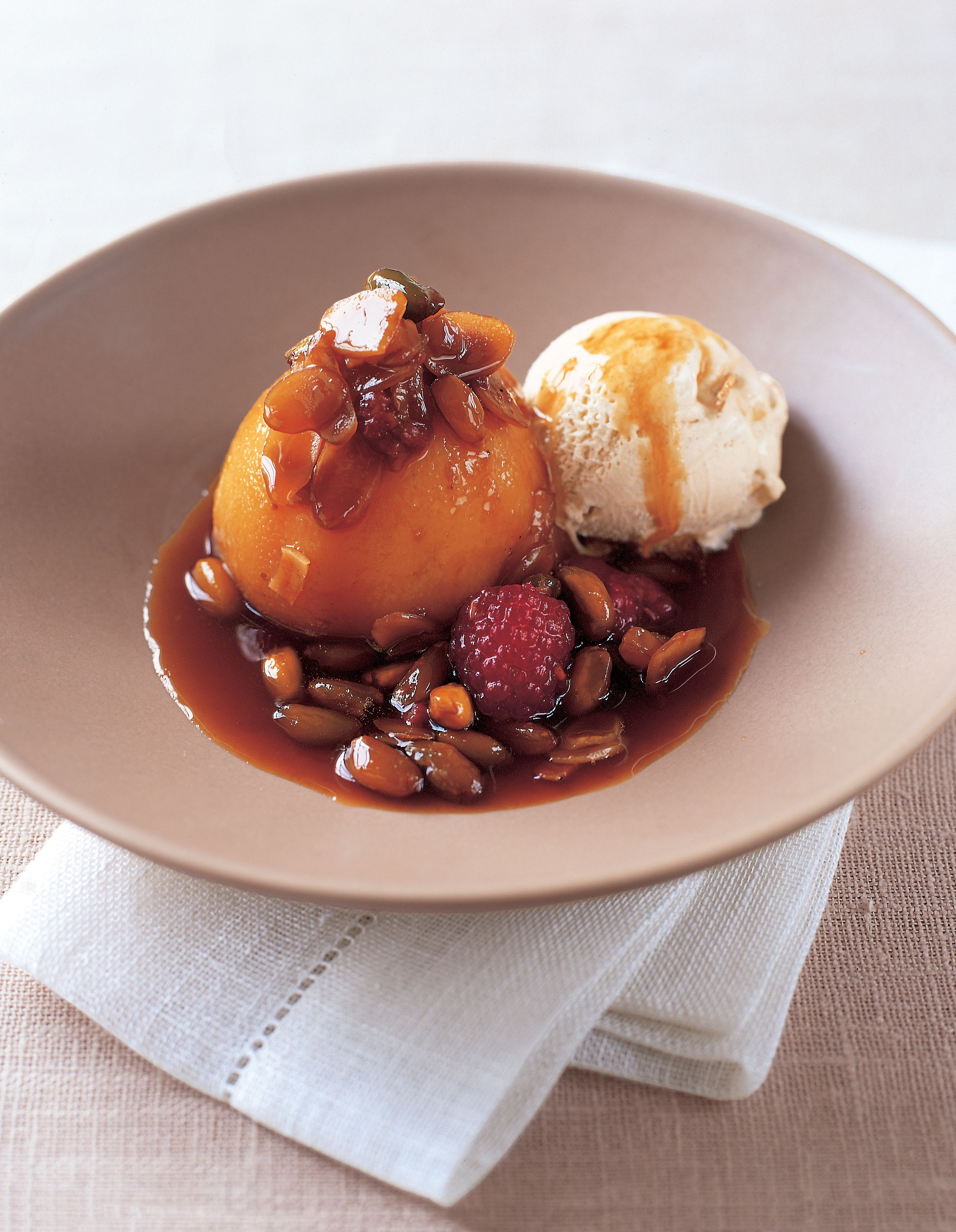 Slow-roasted peaches with orange caramel sauce