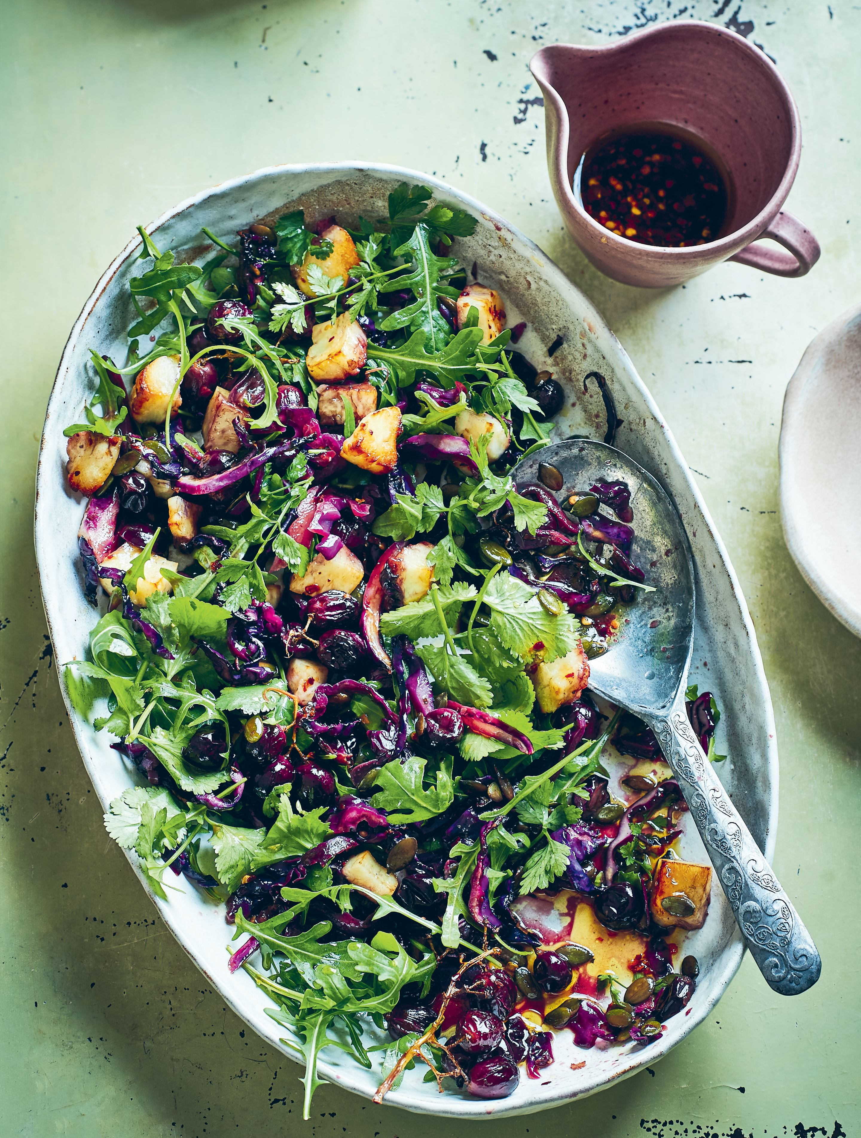 Warm salad of red cabbage, grapes and halloumi