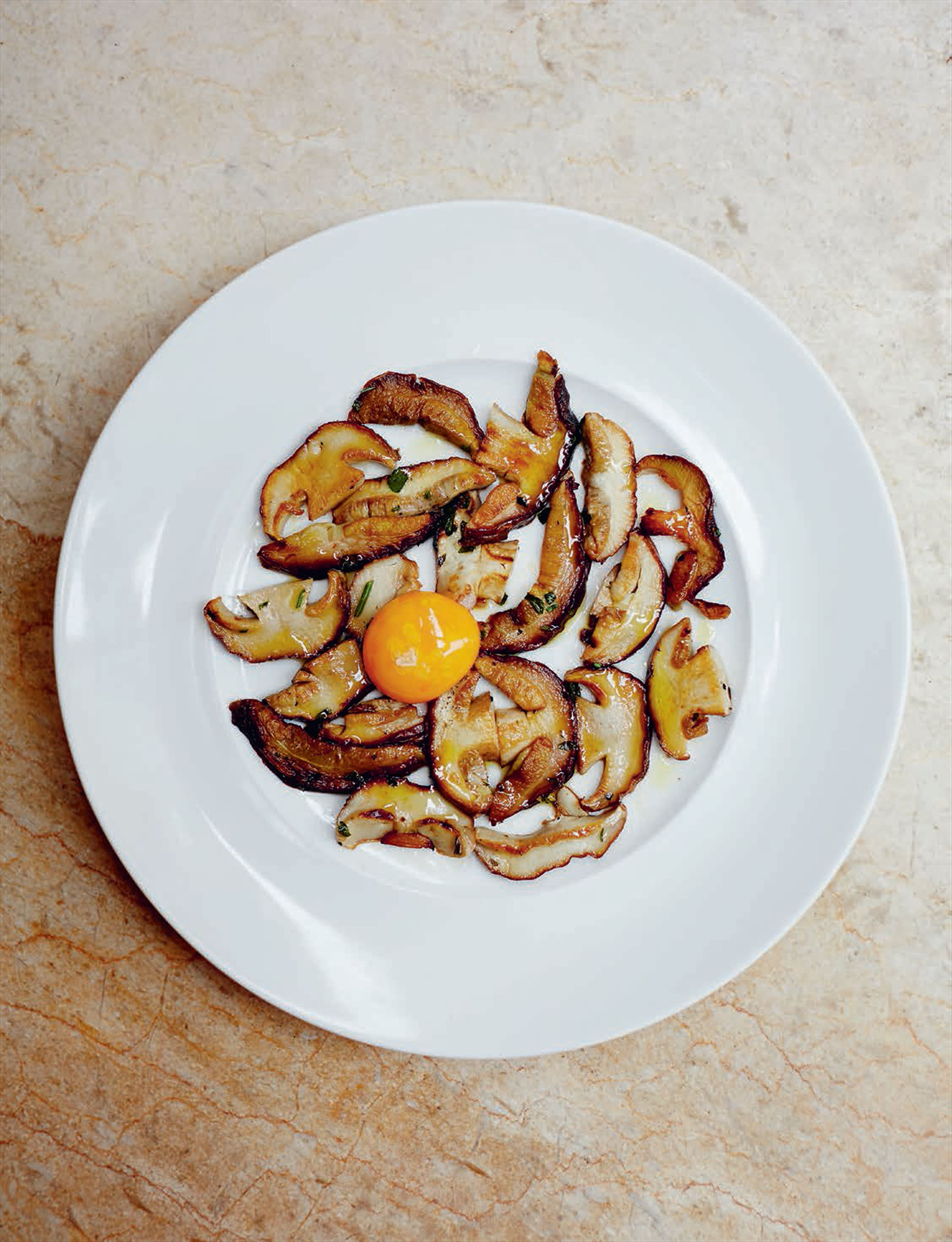 Pan-fried ceps with egg yolk