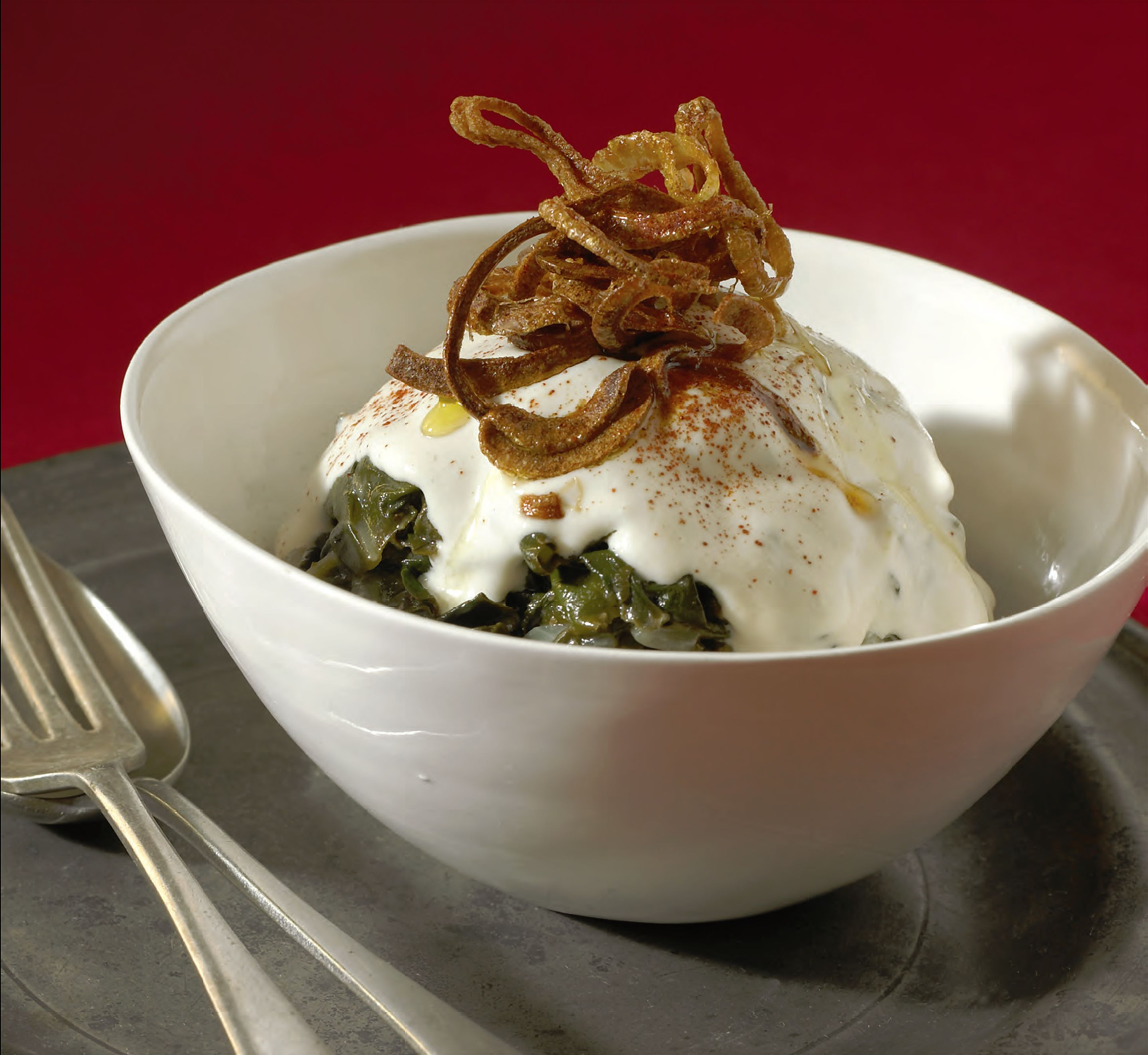 Braised silverbeet with crisp fried onions and tahini sauce
