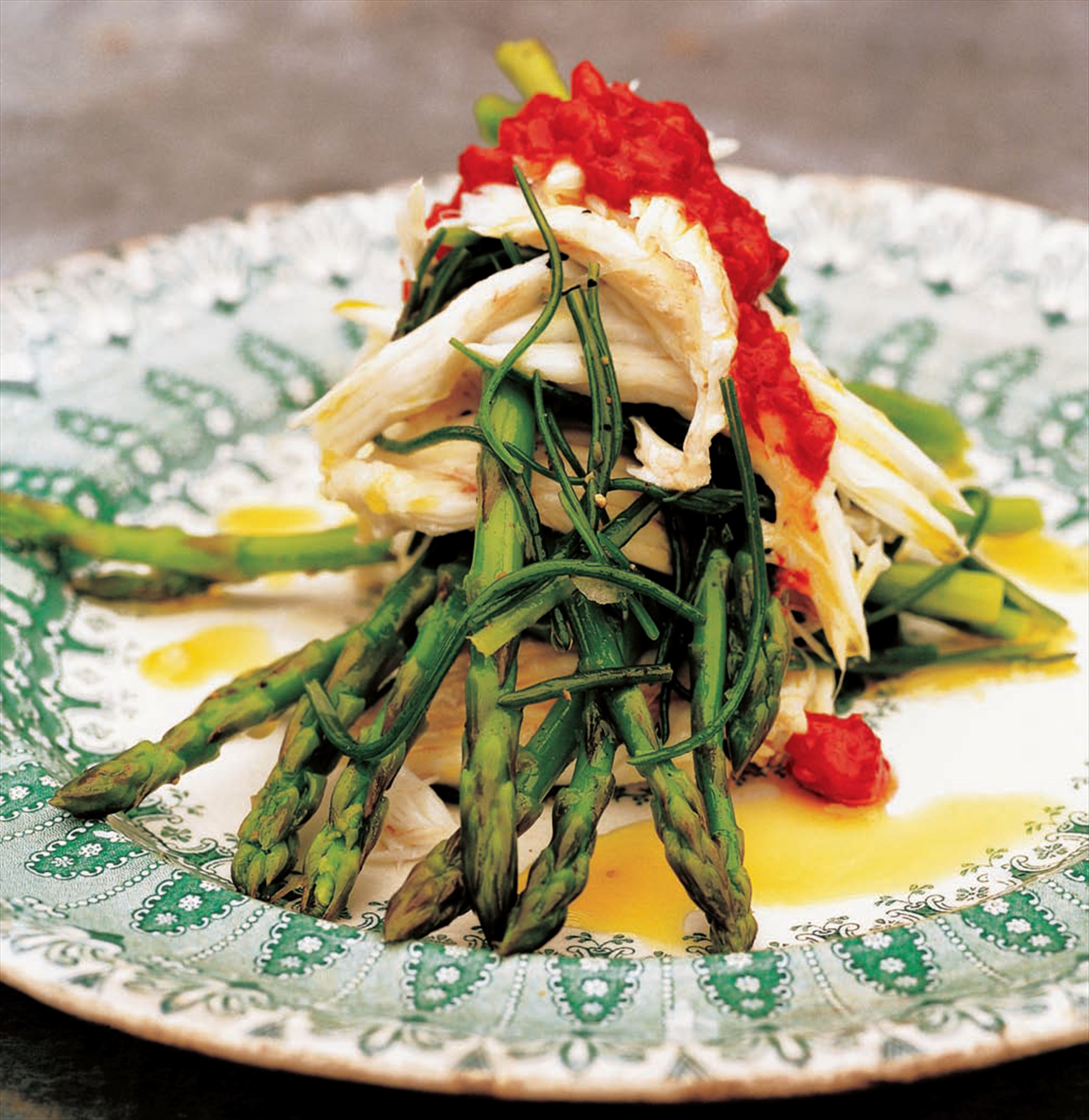 Asparagus with agretti, chilli oil and poached skate