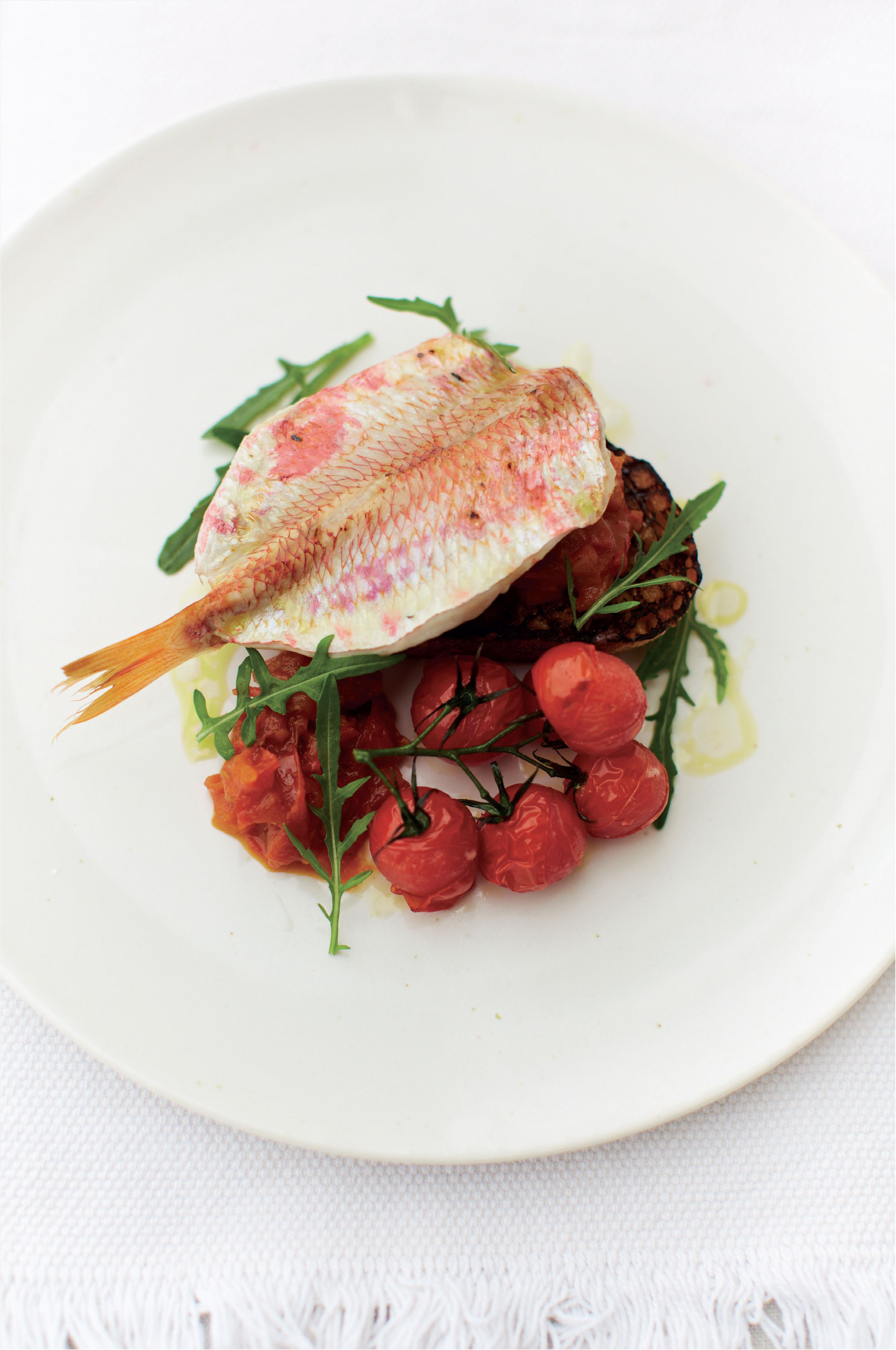 Grilled red mullet on toast with tomato and saffron pickle