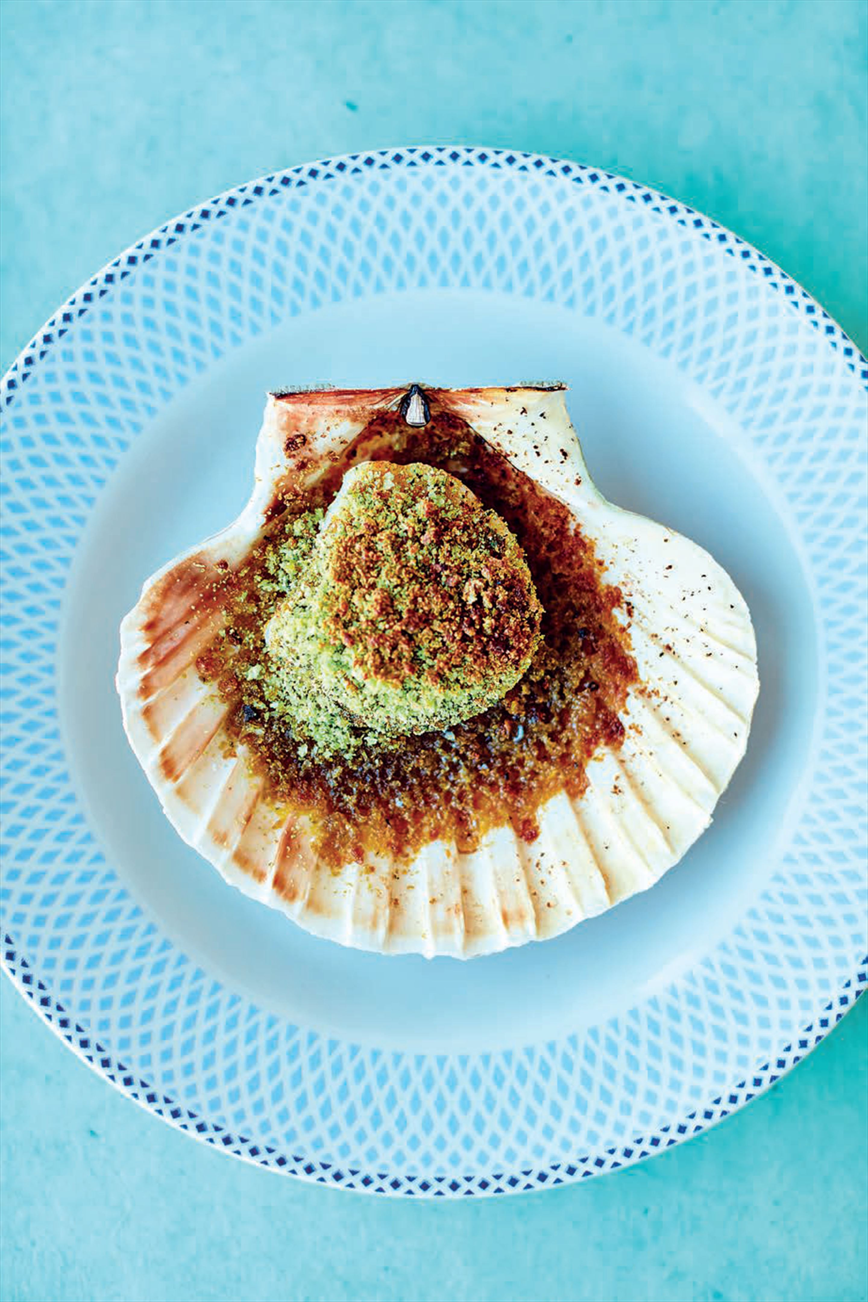 Scallops with cheddar crumbs, smoked paprika and coriander butter