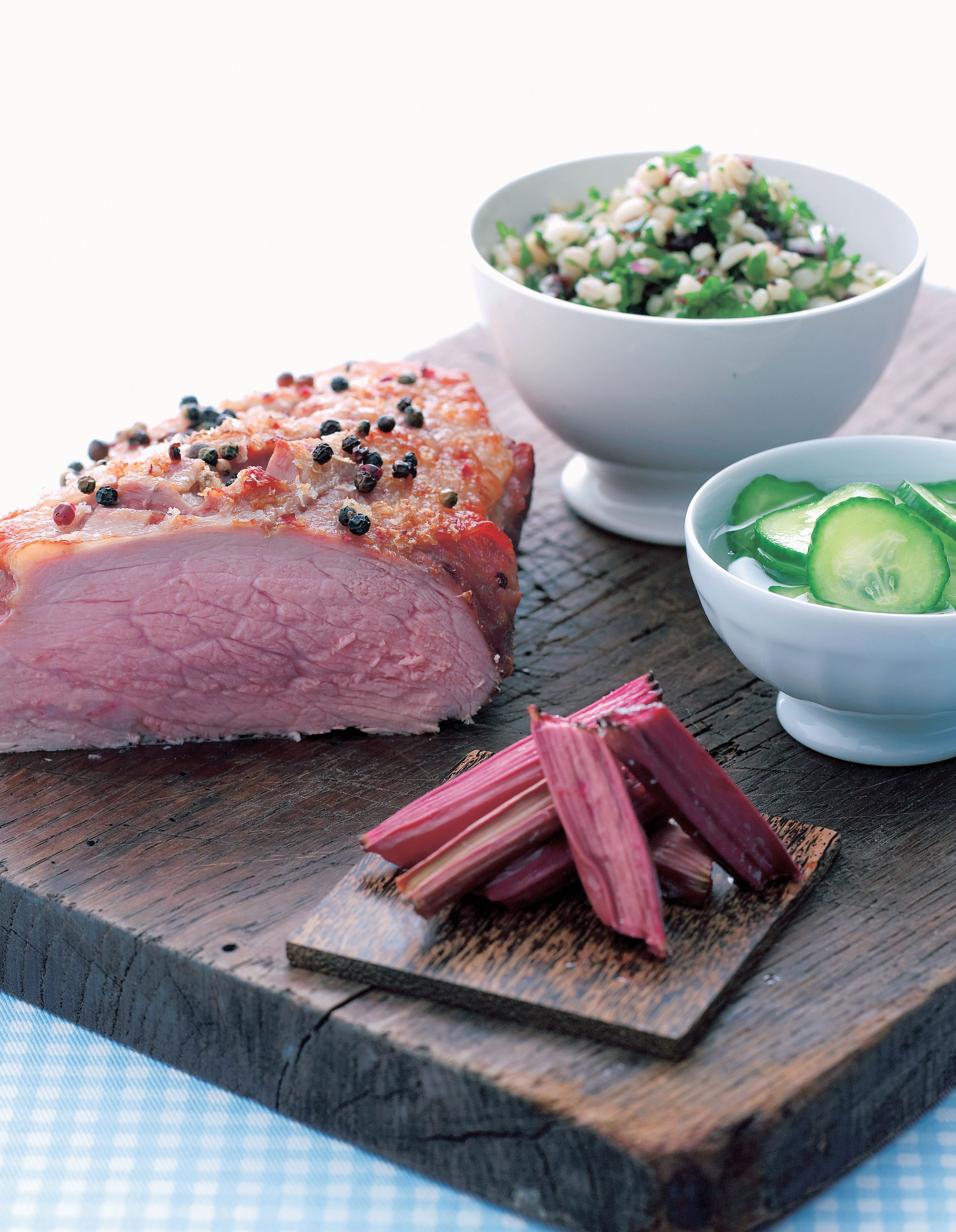 Veal with baked rhubarb, sweet and sour cucumber salad, and barley salad