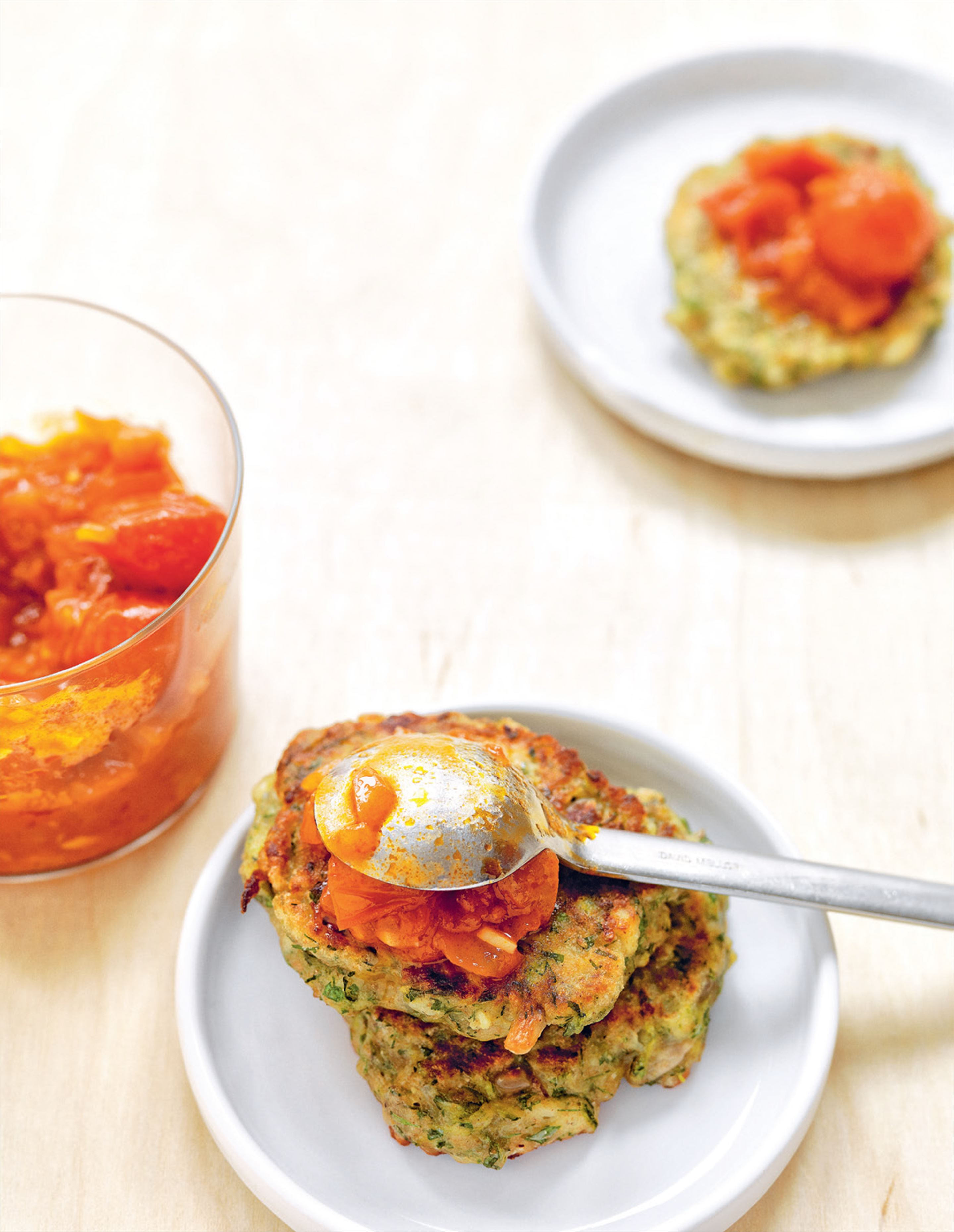 Zucchini & feta fritters with sunflower kernels & tomato sauce