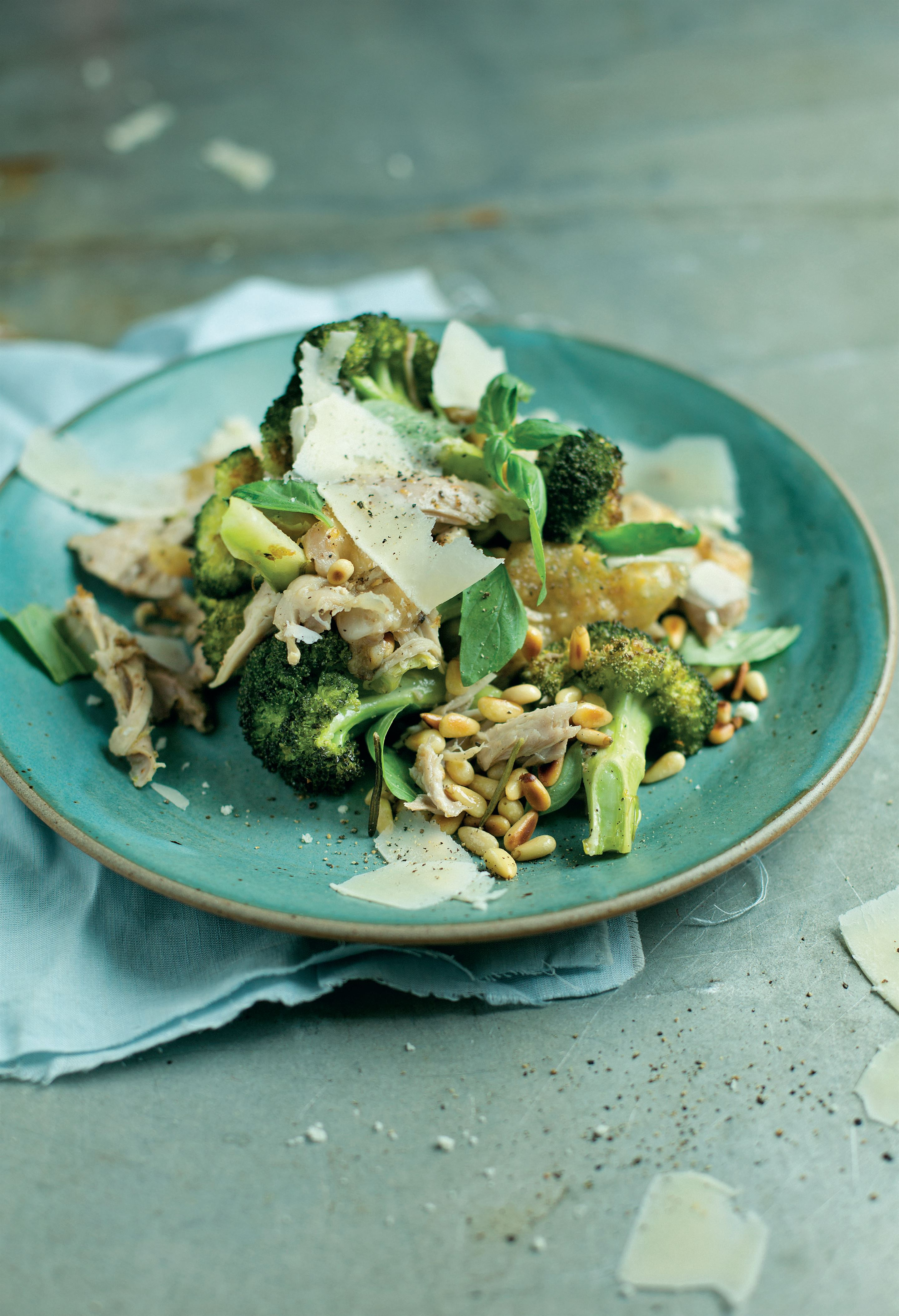 Roast broccoli with shredded chicken, pine nuts and basil
