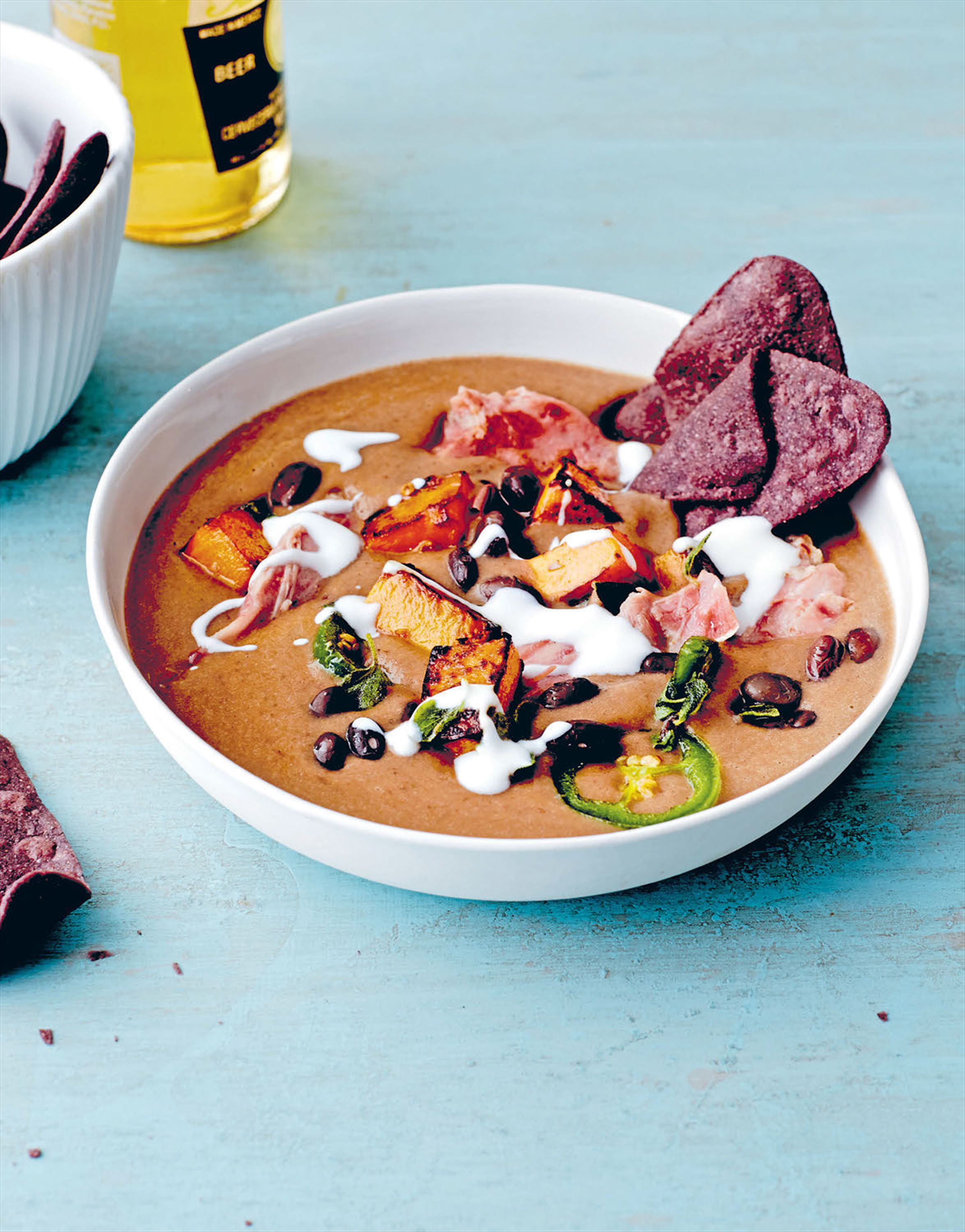 Black & blue corn tortilla soup with bacon & pumpkin