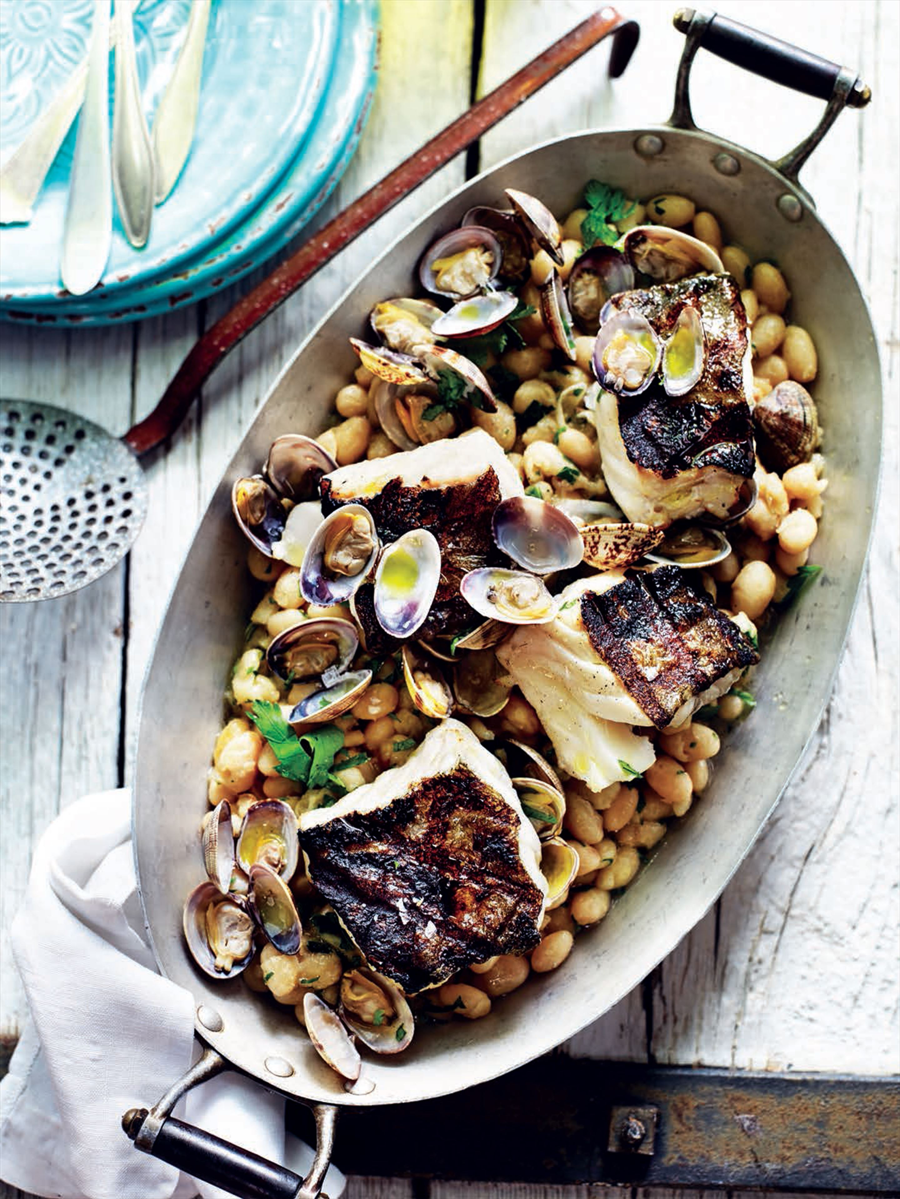 Smoked cod with white beans, clams and parsley