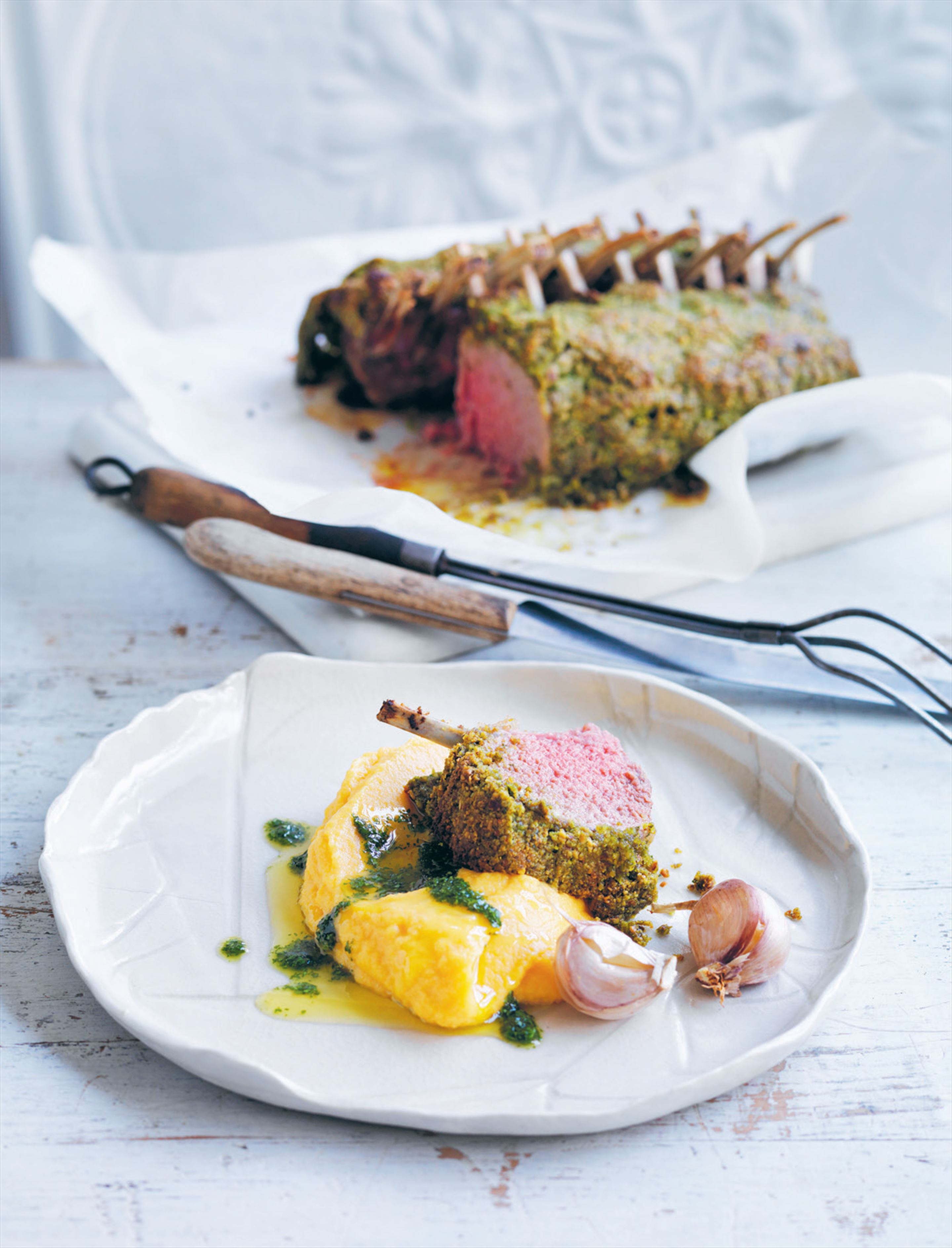 Herb-crusted lamb racks with roast pumpkin and cauliflower purée
