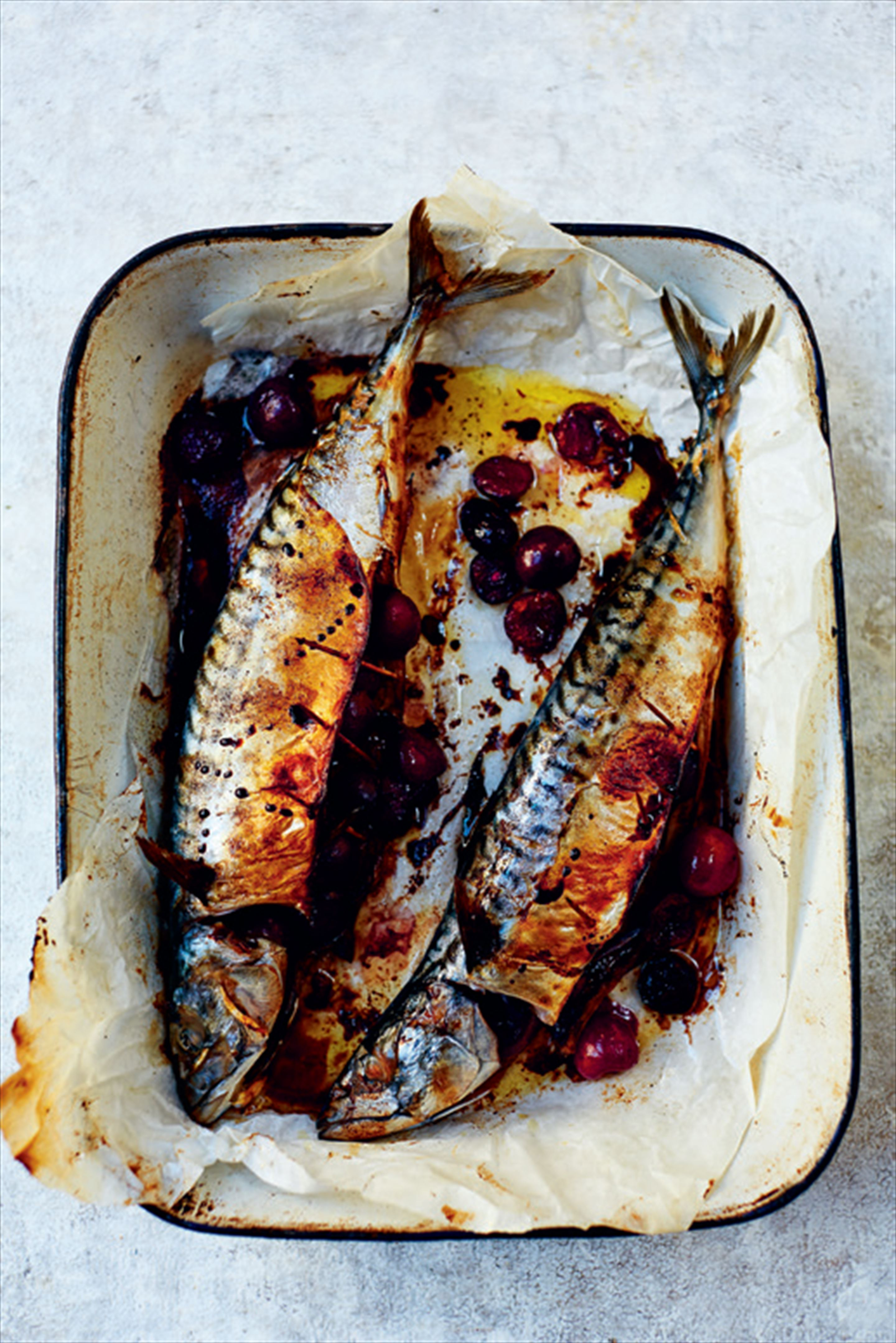 Baked mackerel with wild cherries