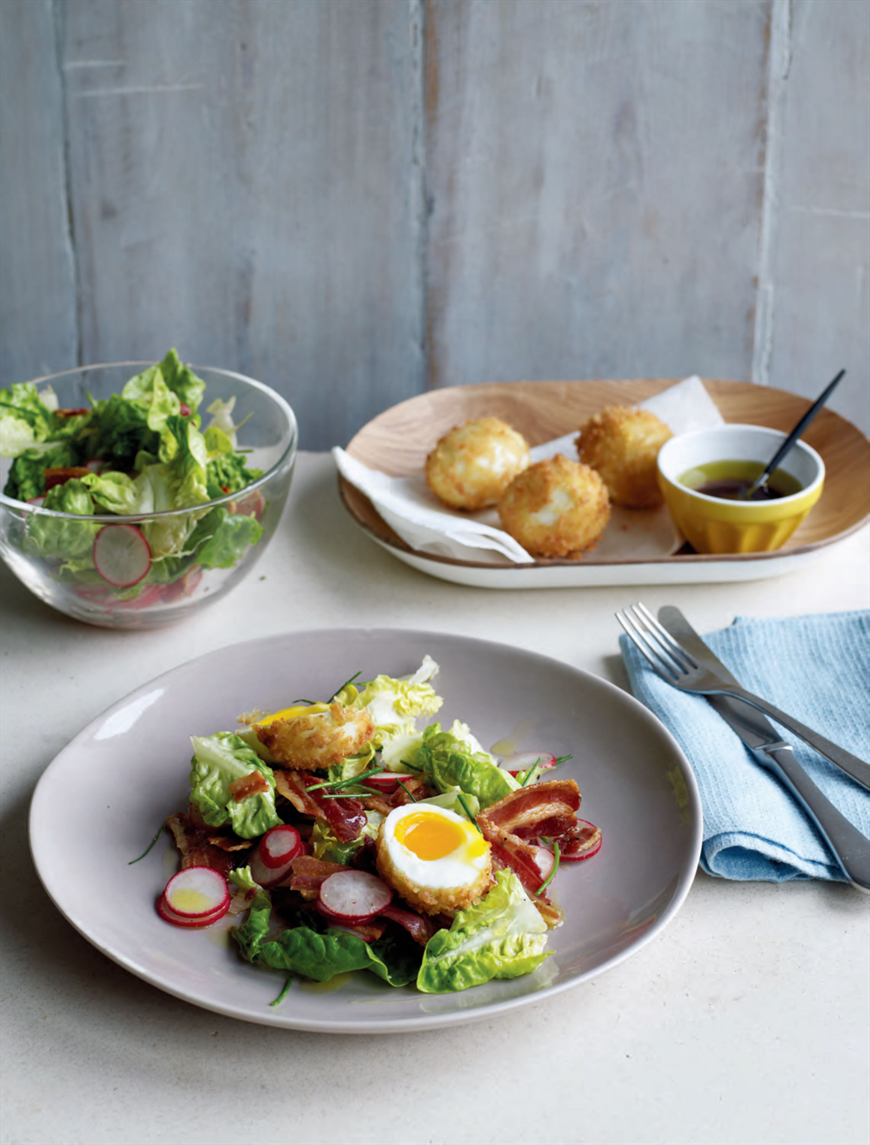 Deep-fried soft-boiled egg with crispy bacon salad