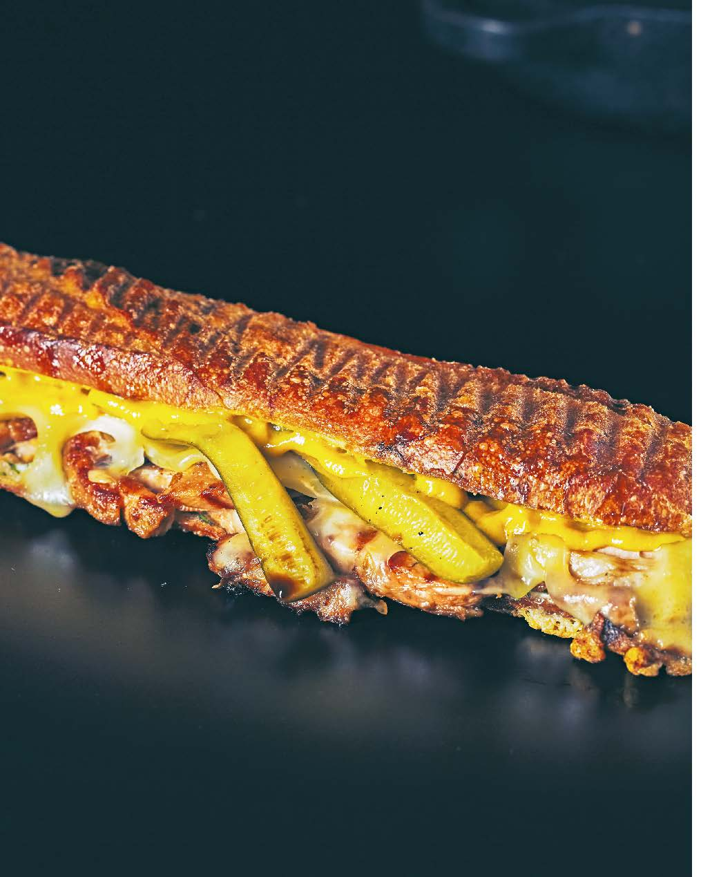 Cubano: barbecued marinated pork shoulder, emmental + dill pickle